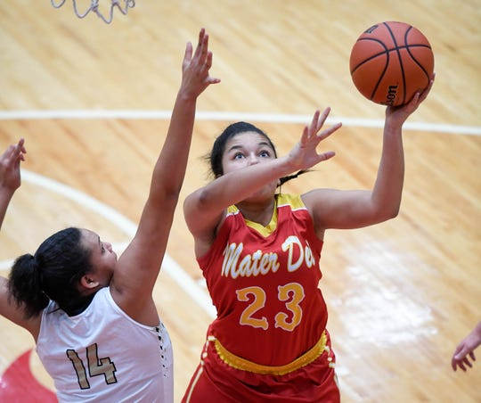 Mater Dei's Mariah Dickerson (23) shoots over defense from Winchester Community's Kira Robinson (14) as the Evansville Mater Dei Wildcats play the Winchester Community Golden Falcons in the Class 2A Girls Semi-State Tournament at Jeffersonville High School Saturday, February 16, 2019.