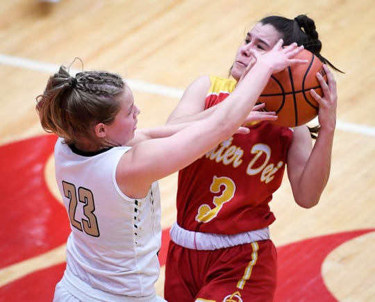 Mater Dei's Hannah Winiger (3) is fouled by Winchester Community's Hannah Graft (23) as the Evansville Mater Dei Wildcats play the Winchester Community Golden Falcons in the Class 2A Girls Semi-State Tournament at Jeffersonville High School Saturday, February 16, 2019.