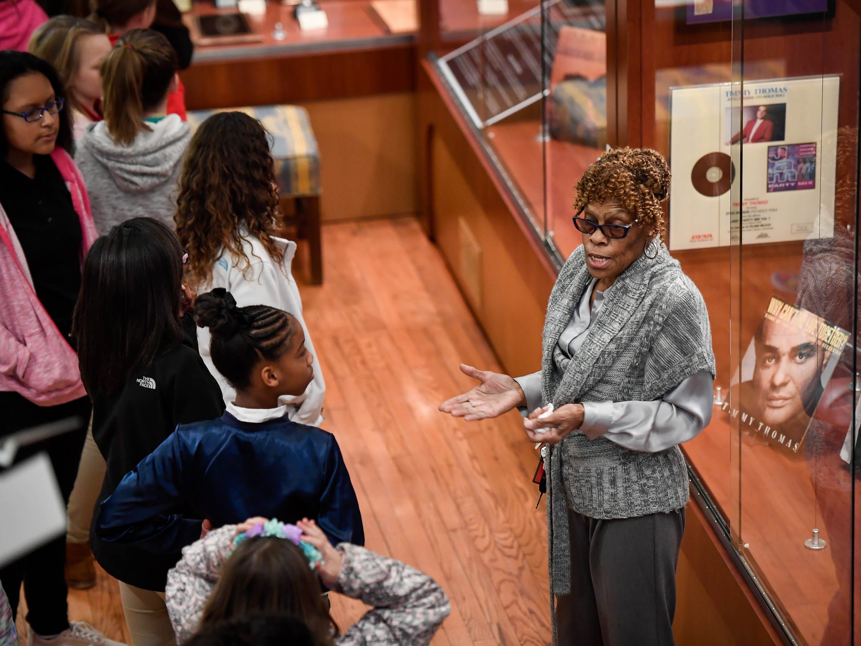 Museum worker Janice Hale leads a group of Dexter Elementary fifth graders on a tour of the Evansville African American Museum on Friday, February 15, 2019.