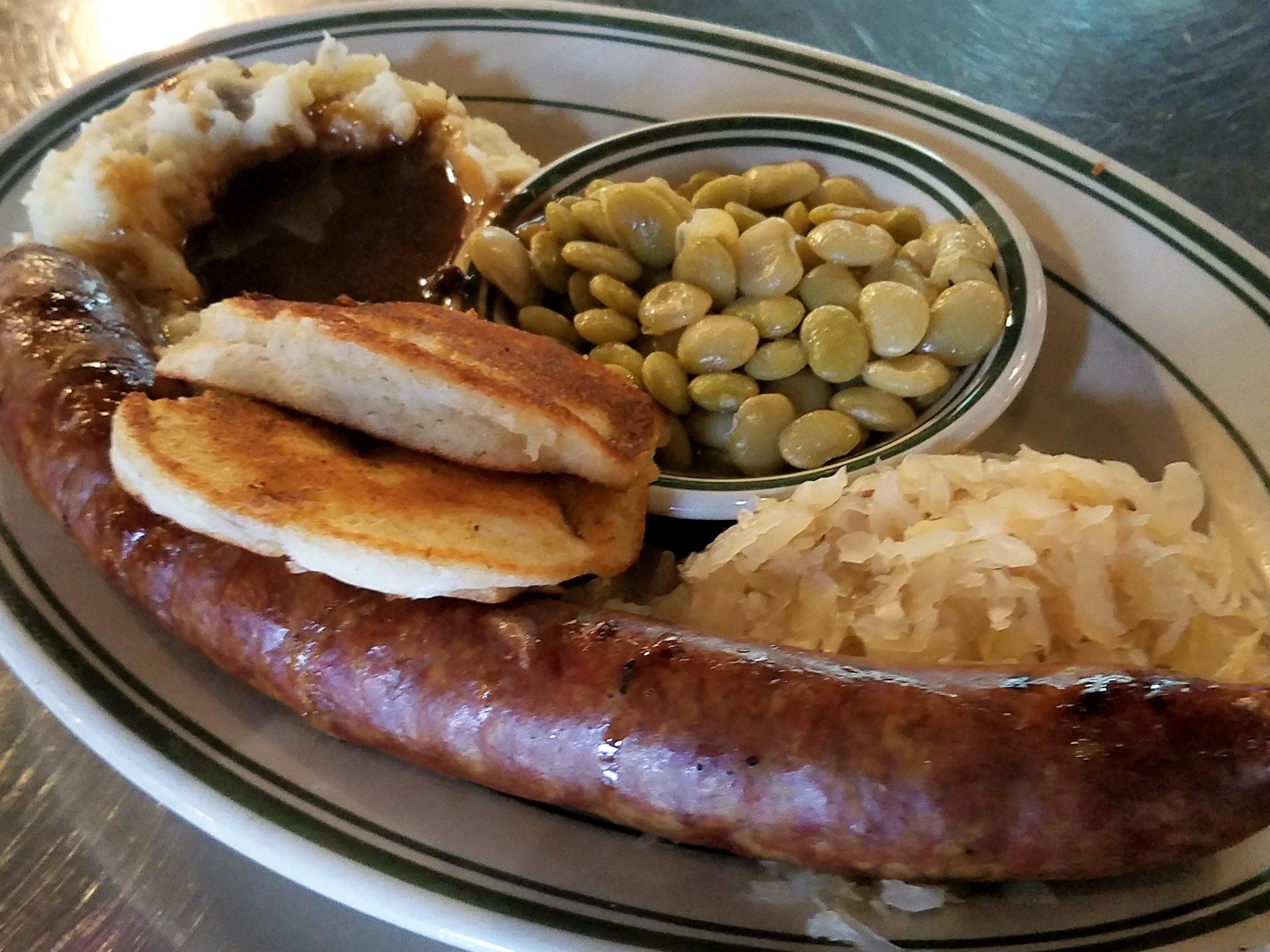 Smoked mett sausage with German sides and fresh-fried cornbread at the Gerst Haus.