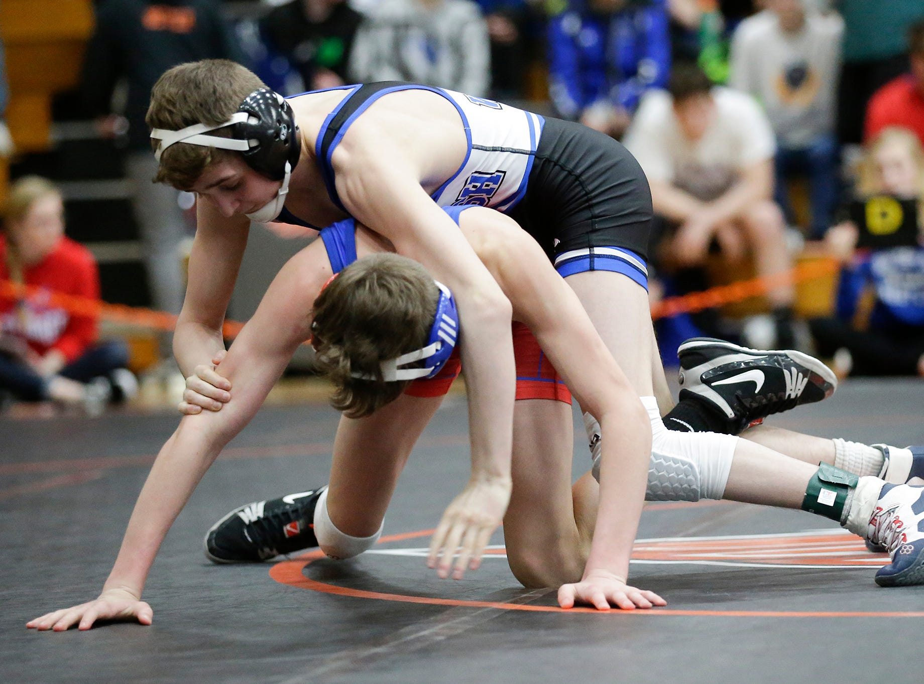 Alec Hunter of Oshkosh West High School wrestles Carter Ziebell of Slinger High School in the 106 pound weight class during the WIAA sectionals Saturday, February 16, 2019 in Hartford, Wis. Hunter won with a score of 5-3. Doug Raflik/USA TODAY NETWORK-Wisconsin