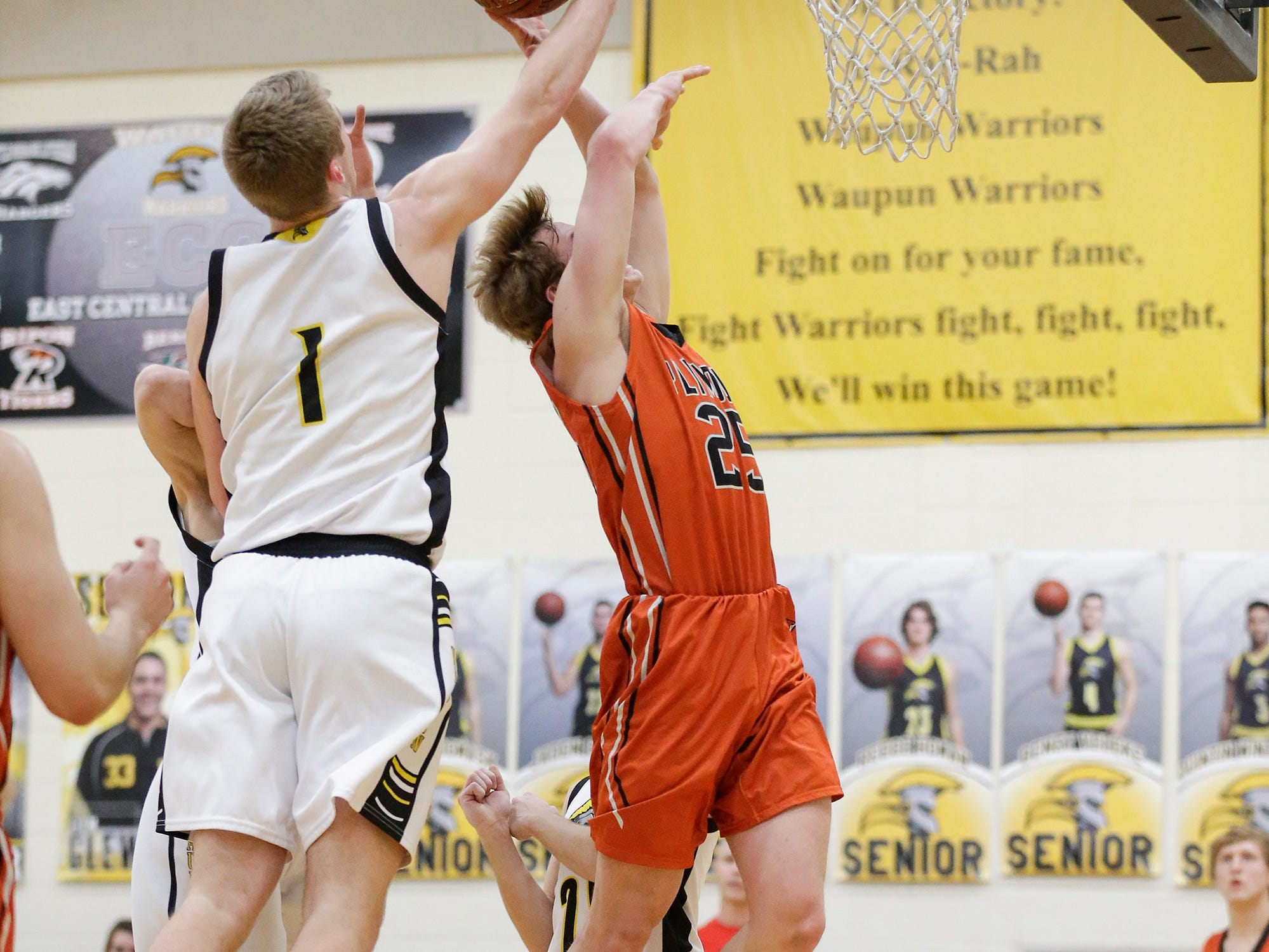 Waupun High School boys basketball's Marcus Domask (1) fouls Plymouth High School's Aiden Reilly (25) during their game Friday, February 15, 2019 in Waupun. Doug Raflik/USA TODAY NETWORK-Wisconsin