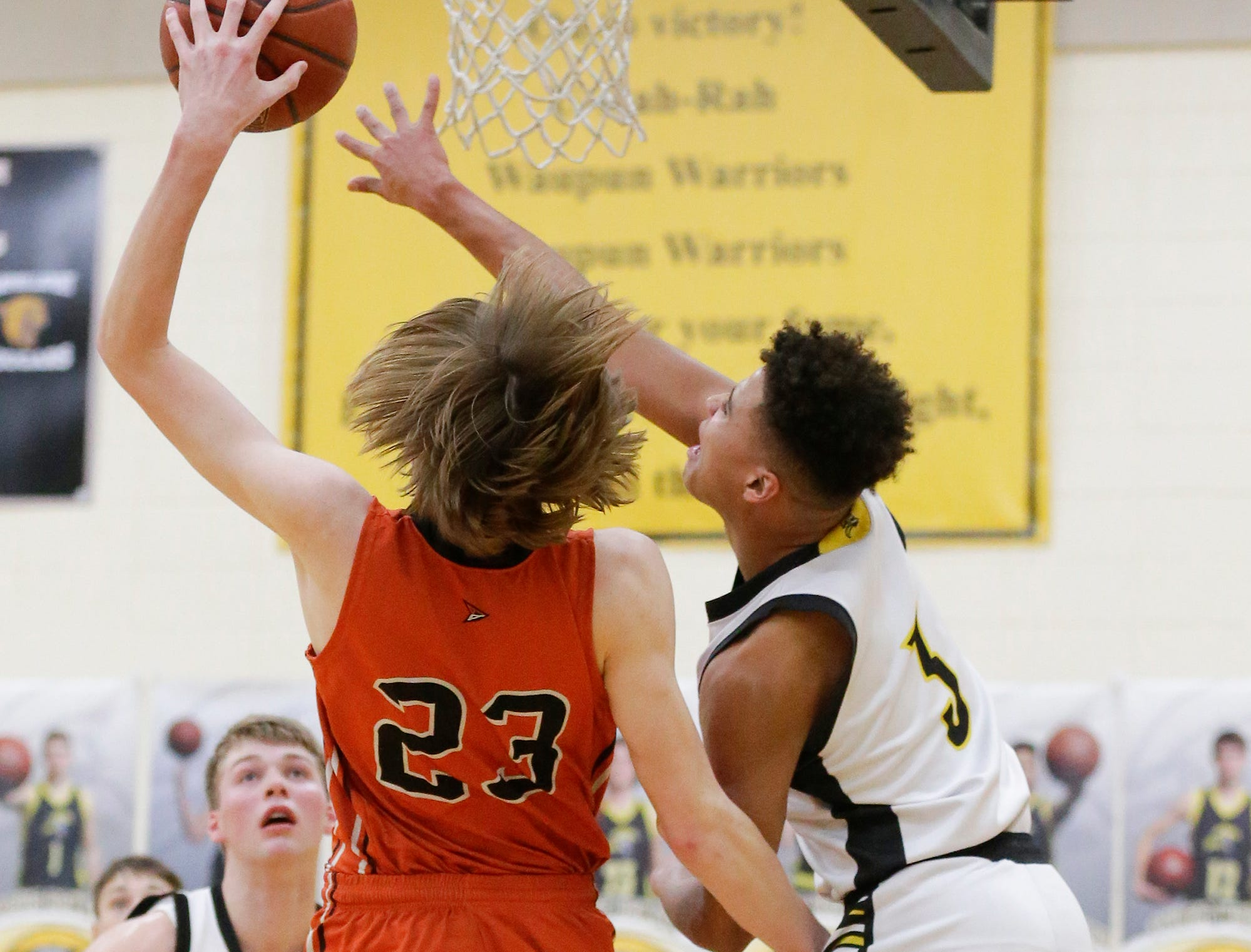 Waupun High School boys basketball's Quintin Winterfeldt (3) and Plymouth High School's Zach Zeeveld battle for a rebound during their game Friday, February 15, 2019 in Waupun. Doug Raflik/USA TODAY NETWORK-Wisconsin