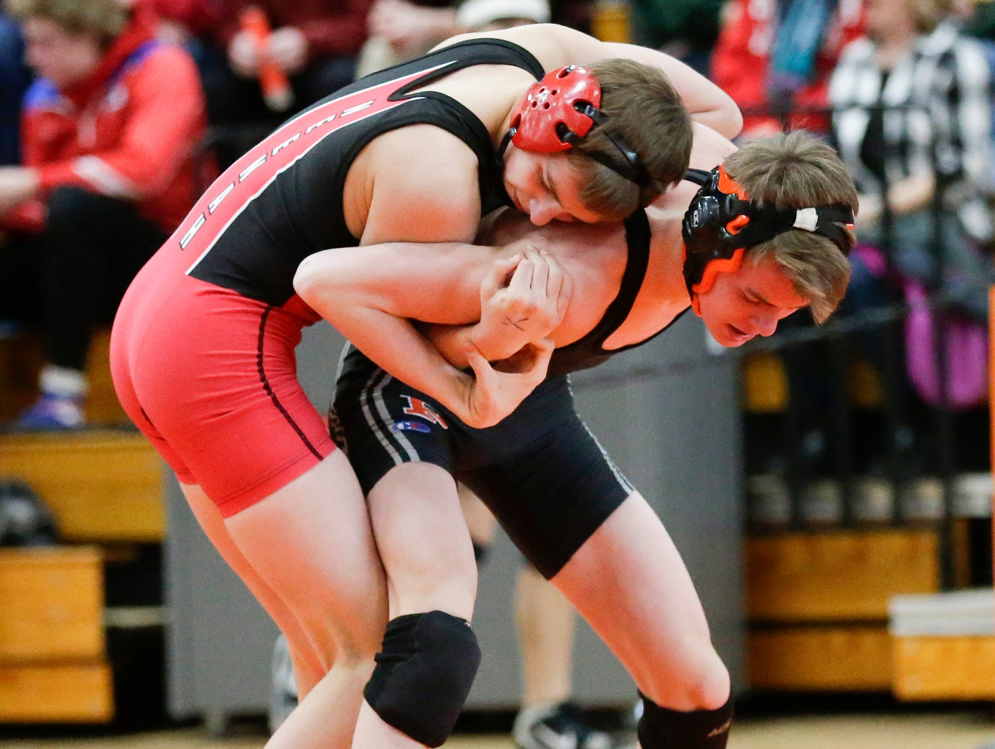 Drake Hayward of Neenah High School wrestles Andrew Steinhardt of Plymouth High School in the 126 pound weight class during the WIAA sectionals Saturday, February 16, 2019 in Hartford, Wis. Hayward won with a pin. Doug Raflik/USA TODAY NETWORK-Wisconsin