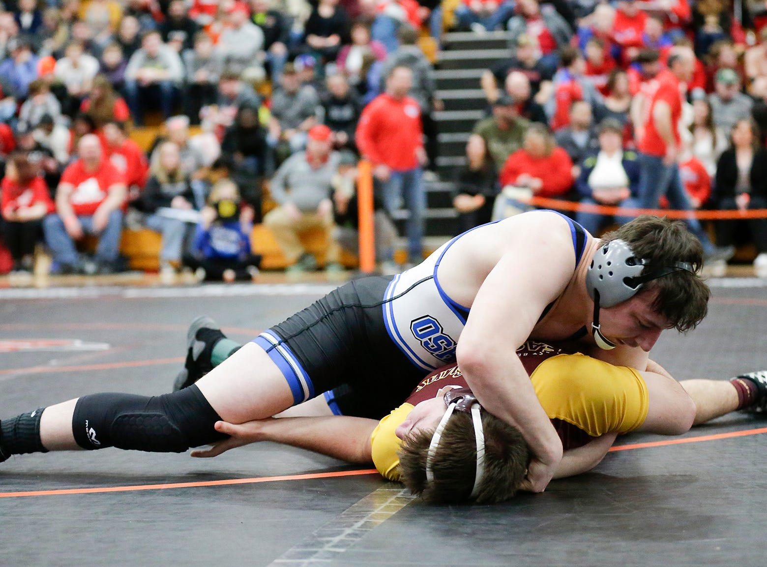 Kevin Loos of Oshkosh West High School wrestles Evan Smith of West Bend East High School in the 195 pound weight class during the WIAA sectionals Saturday, February 16, 2019 in Hartford, Wis. Loos won with a pin. Doug Raflik/USA TODAY NETWORK-Wisconsin