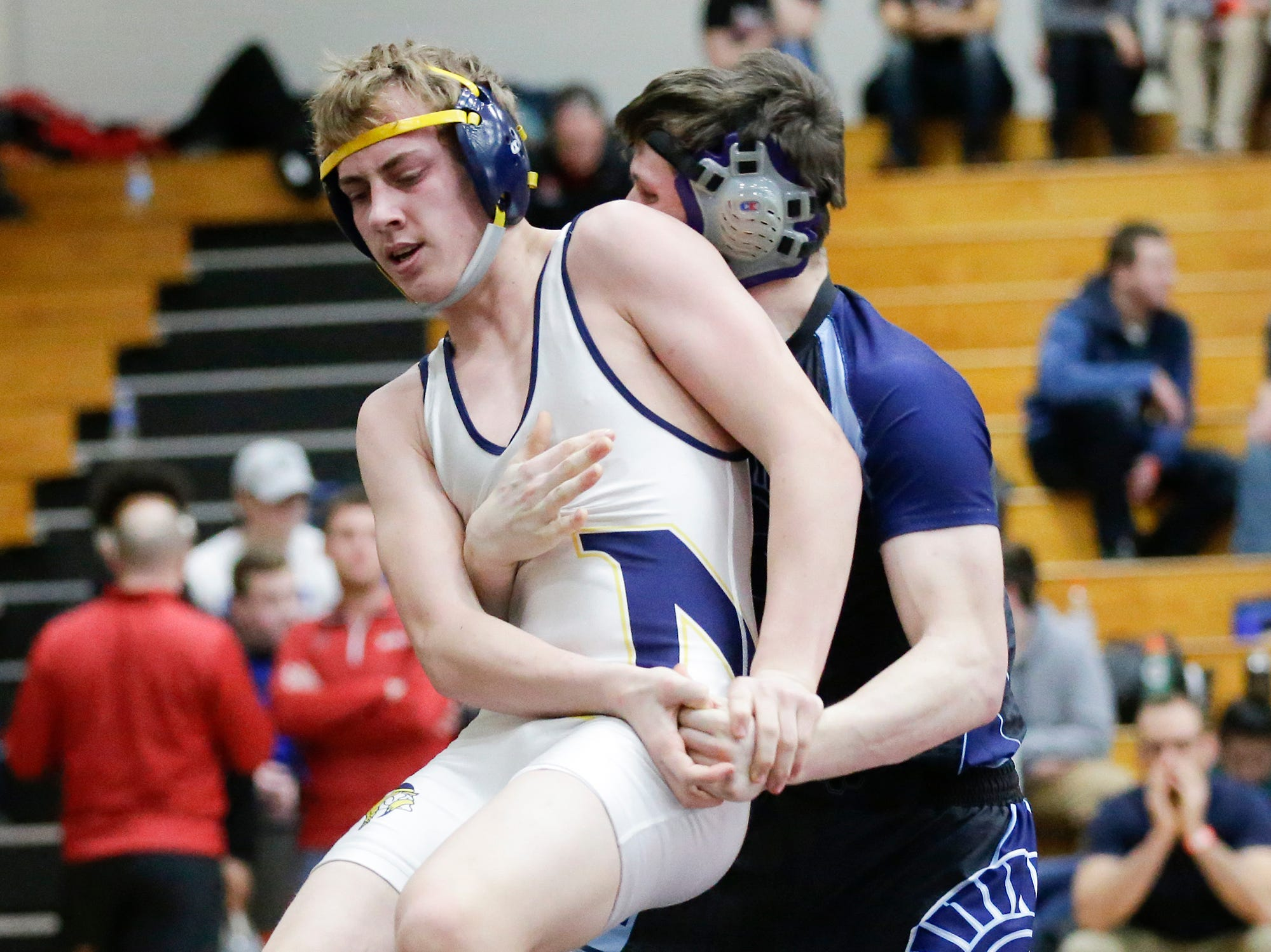 Josh Johnson of West Bend West High School wrestles Kade Allen of Sheboygan North High School in the 160 pound weight class during the WIAA sectionals Saturday, February 16, 2019 in Hartford, Wis. Johnson won with a score of 14-4. Doug Raflik/USA TODAY NETWORK-Wisconsin