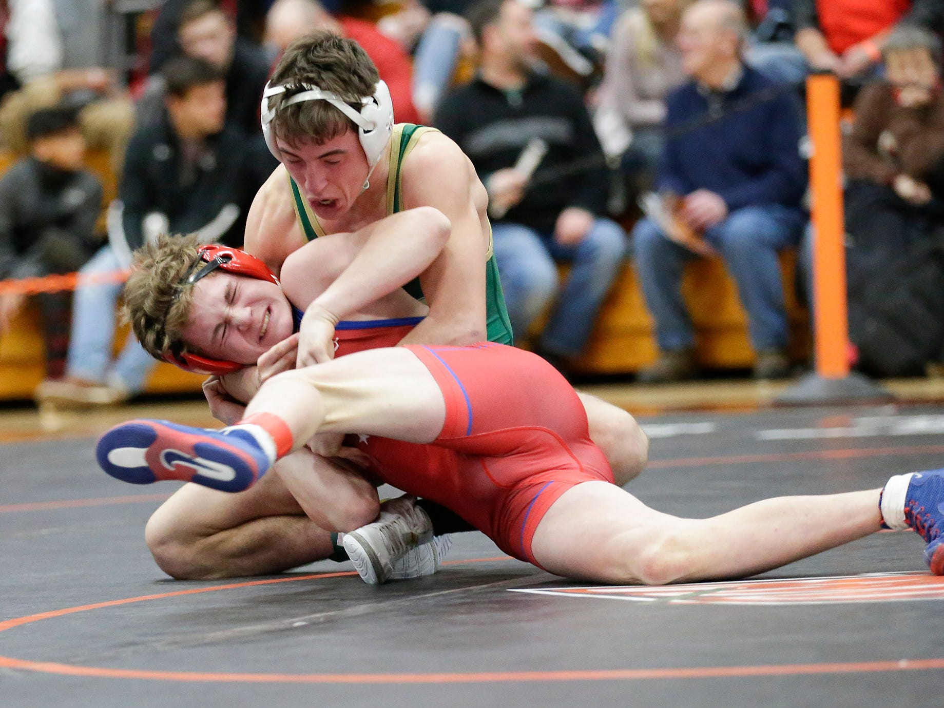 Jake Melzer of Slinger High School wrestles Cade Schmitz of Oshkosh North High School in the 126 pound weight class during the WIAA sectionals Saturday, February 16, 2019 in Hartford, Wis. Schmitz won with a score of 6-4. Doug Raflik/USA TODAY NETWORK-Wisconsin