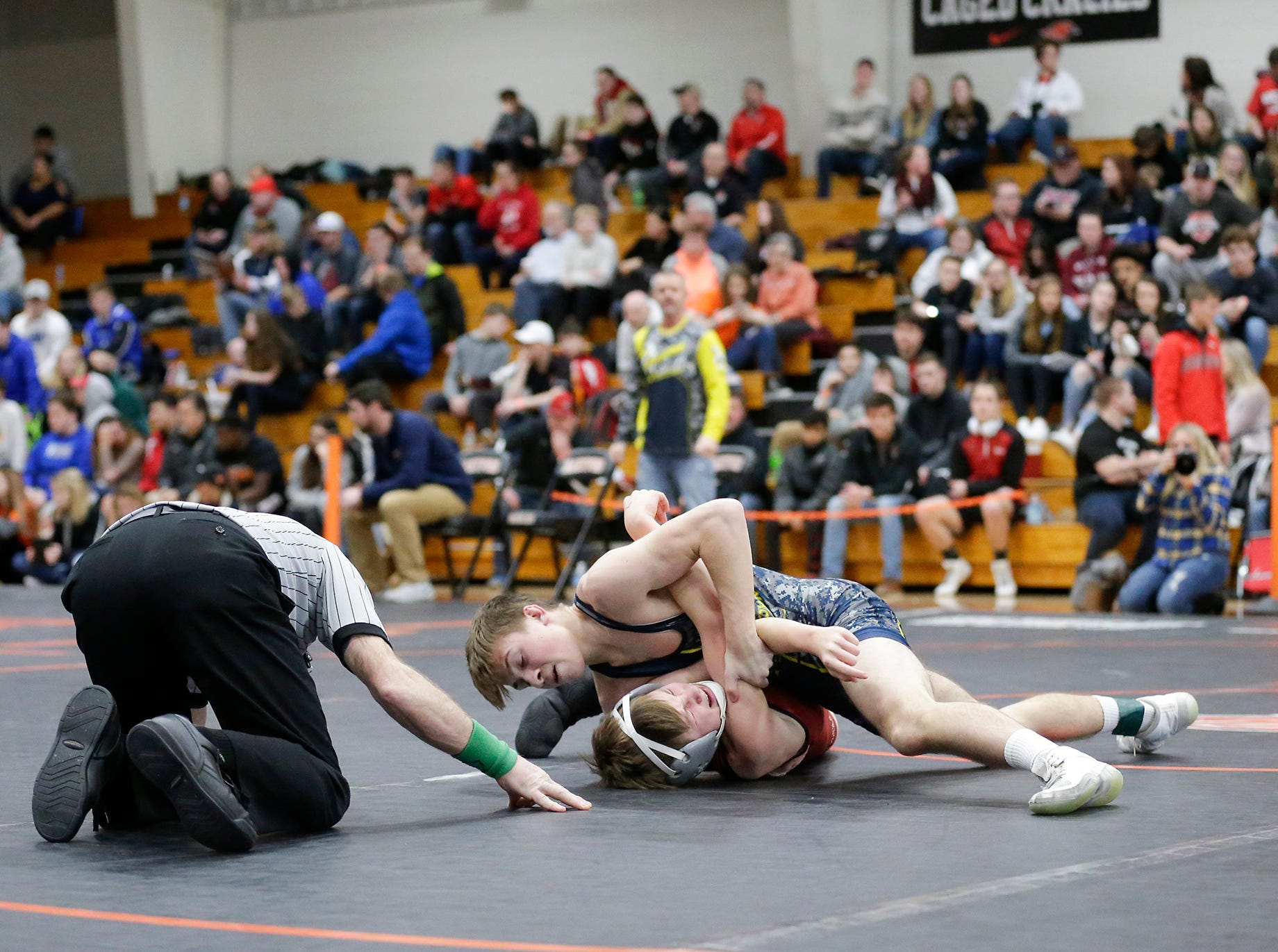 Michael Streblow of Fond du lac High School wrestles Tyler Schiesl of Germantown High School in the 113 pound weight class during the WIAA sectionals Saturday, February 16, 2019 in Hartford, Wis. Schiesl won with a pin. Doug Raflik/USA TODAY NETWORK-Wisconsin