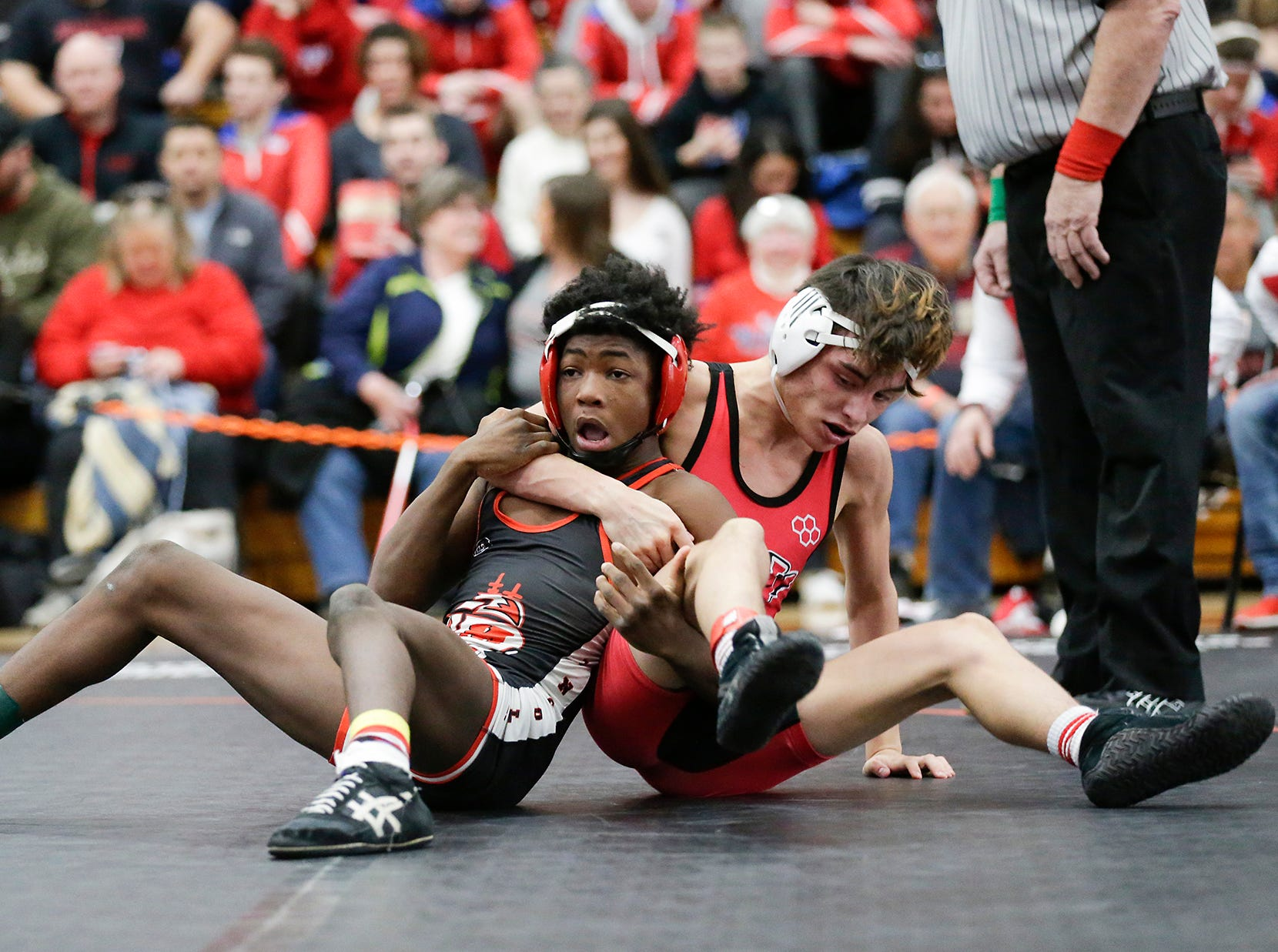 Dante Caiani of Neenah High School wrestles Demario Ford of Manitowoc Lincoln High School in the 120 pound weight class during the WIAA sectionals Saturday, February 16, 2019 in Hartford, Wis. Ford won with a score of 2-1. Doug Raflik/USA TODAY NETWORK-Wisconsin