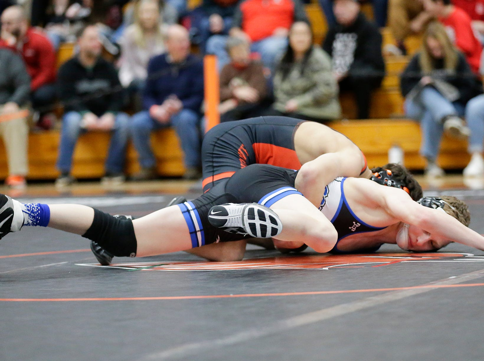 Jalen Spuhler of Hartford Union High School wrestles Logan Grota of Oshkosh West High School in the 132 pound weight class during the WIAA sectionals Saturday, February 16, 2019 in Hartford, Wis. Spuhler won with a pin. Doug Raflik/USA TODAY NETWORK-Wisconsin