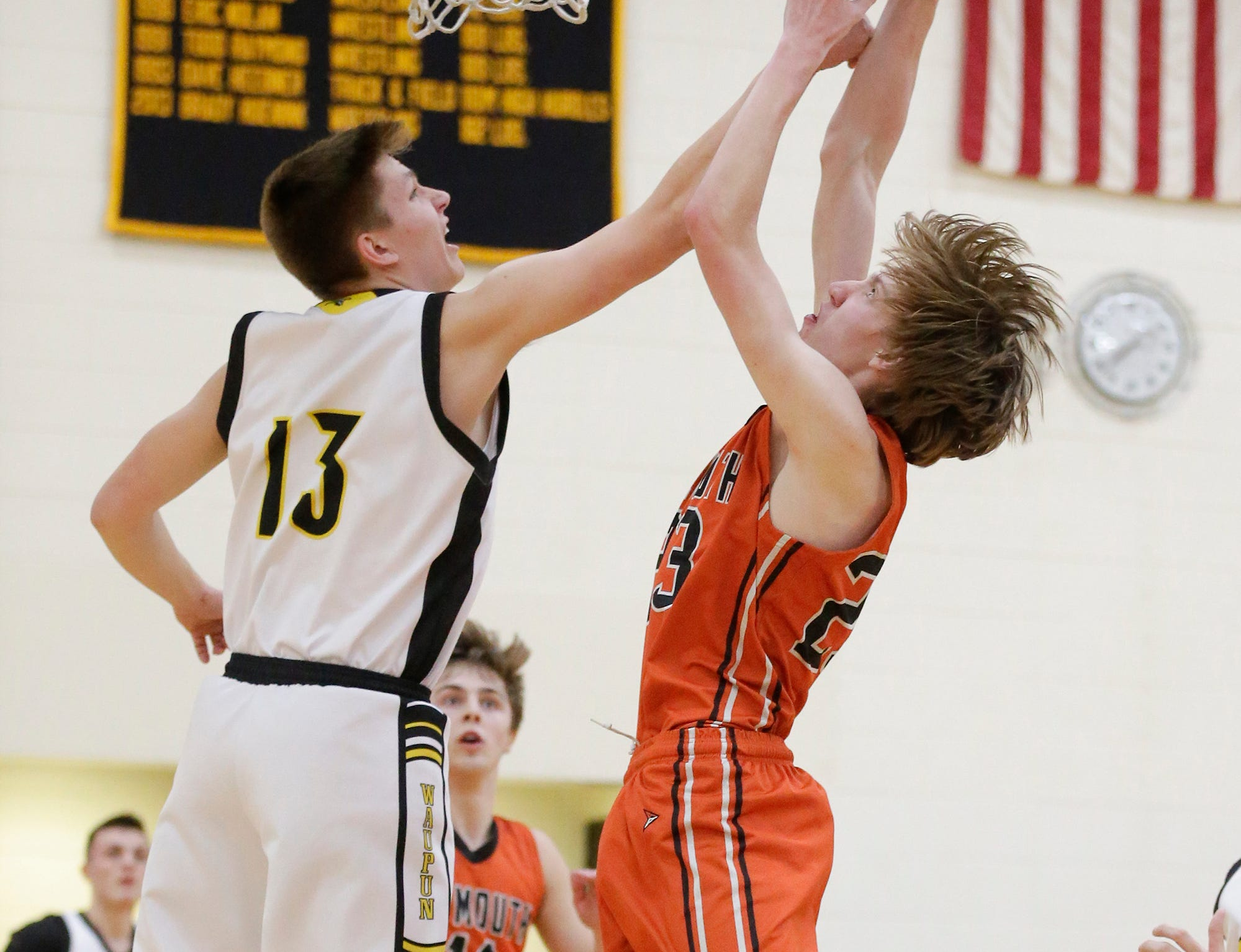 Waupun High School boys basketball's Conner Kamphuis (13) and Plymouth High School's Zach Zeeveld (23) battle for a rebound during their game Friday, February 15, 2019 in Waupun. Doug Raflik/USA TODAY NETWORK-Wisconsin