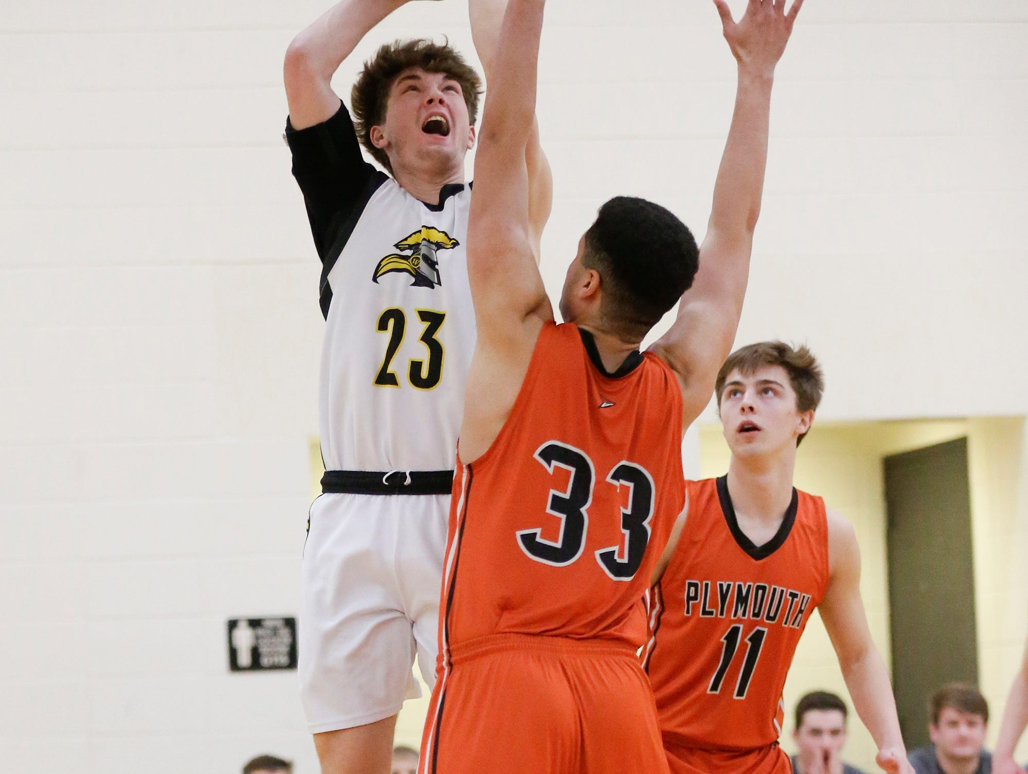 Waupun High School boys basketball's Reece Homan (23) goes up for a basket over Plymouth High School's Nick Falls (33) during their game Friday, February 15, 2019 in Waupun. Doug Raflik/USA TODAY NETWORK-Wisconsin