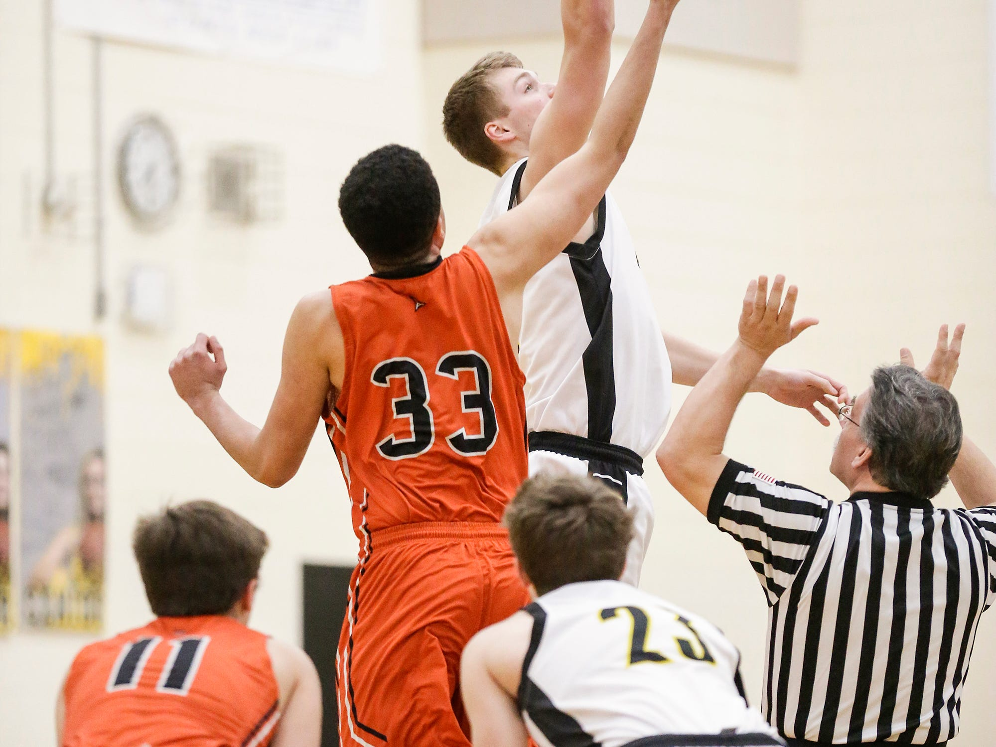 Waupun High School boys basketball's Marcus Domask gets the opening tip off over Plymouth High School's Nick Falls (33) during their game Friday, February 15, 2019 in Waupun. Doug Raflik/USA TODAY NETWORK-Wisconsin