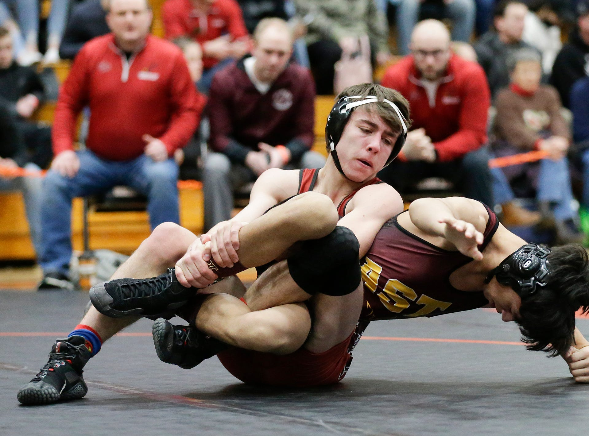 Logan Naker of Fond du Lac High School wrestles Damian Zapata of West Bend East High School in the 145 pound weight class during the WIAA sectionals Saturday, February 16, 2019 in Hartford, Wis. Zapata won with a pin. Doug Raflik/USA TODAY NETWORK-Wisconsin