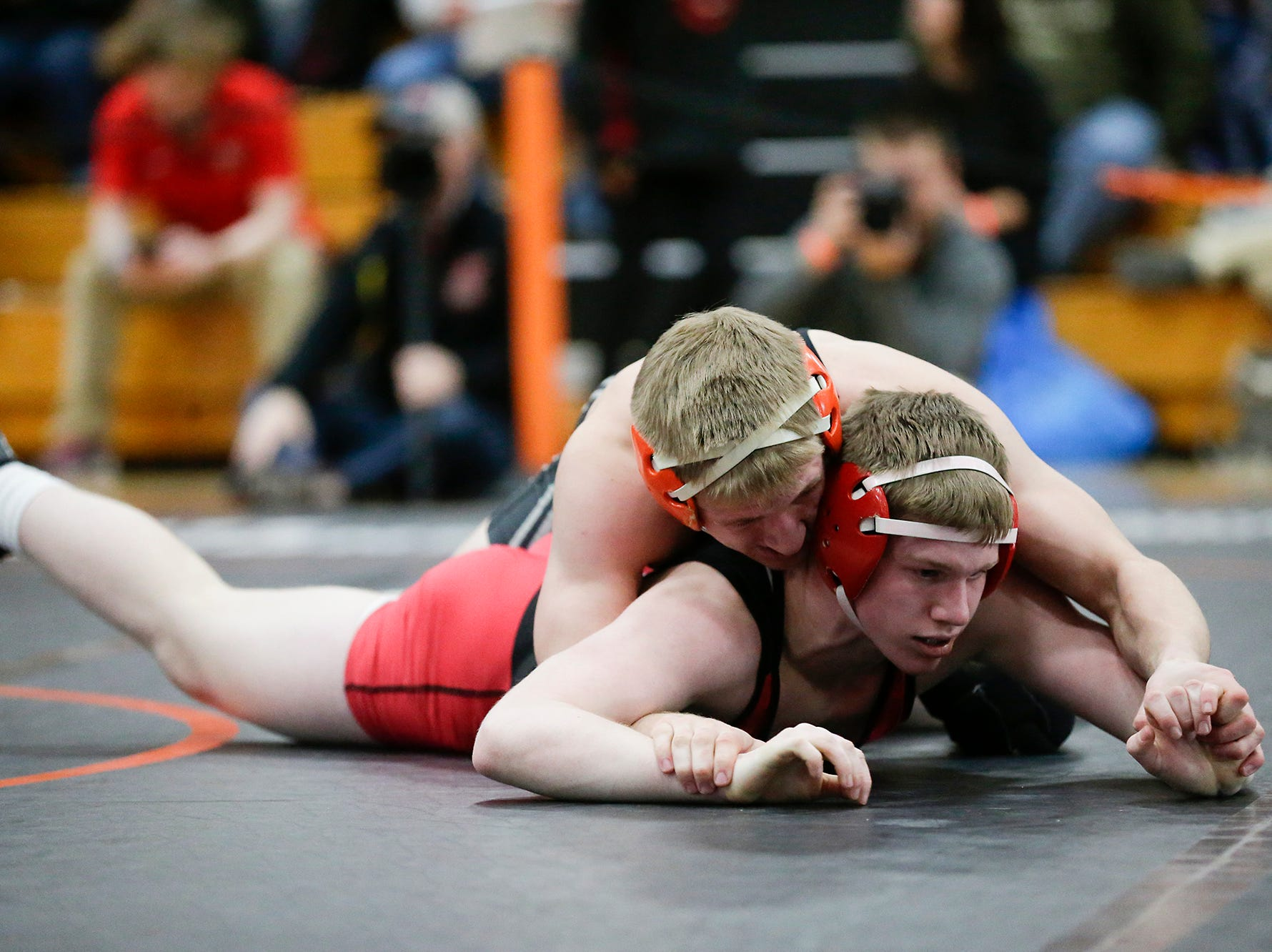 Bryce Crook of Neenah High School wrestles Josh Koll of Plymouth High School in the 160 pound weight class during the WIAA sectionals Saturday, February 16, 2019 in Hartford, Wis. Koll won with a pin. Doug Raflik/USA TODAY NETWORK-Wisconsin