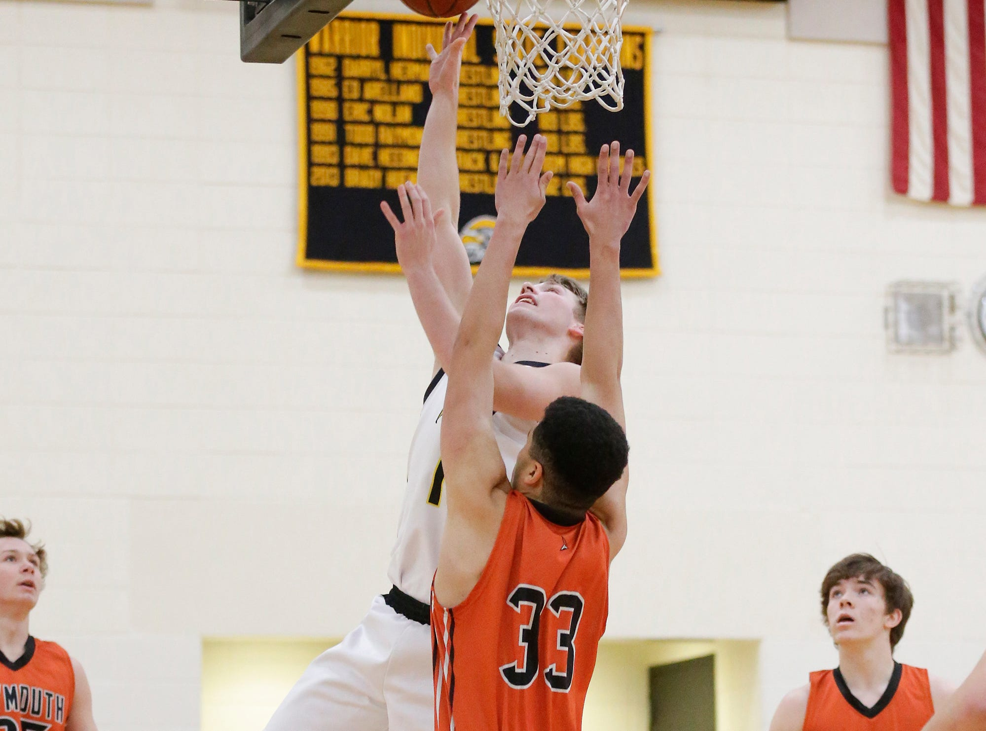 Waupun High School boys basketball's Marcus Domask (1) goes up for a basket over Plymouth High School's Nick Falls (33) during their game Friday, February 15, 2019 in Waupun. Doug Raflik/USA TODAY NETWORK-Wisconsin