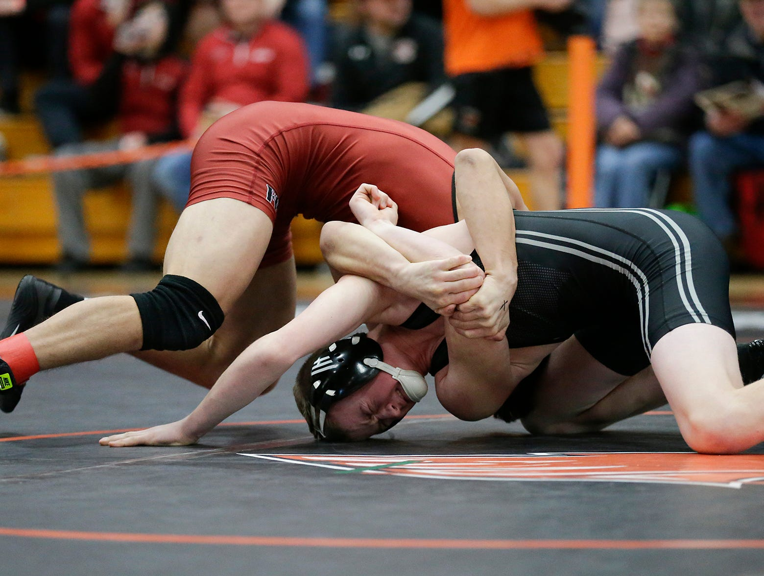 Issac Ortegon of Fond du Lac High School wrestles Jaden Papenfus of Plymouth High School in the 138 pound weight class during the WIAA sectionals Saturday, February 16, 2019 in Hartford, Wis. Ortegon won with a pin. Doug Raflik/USA TODAY NETWORK-Wisconsin