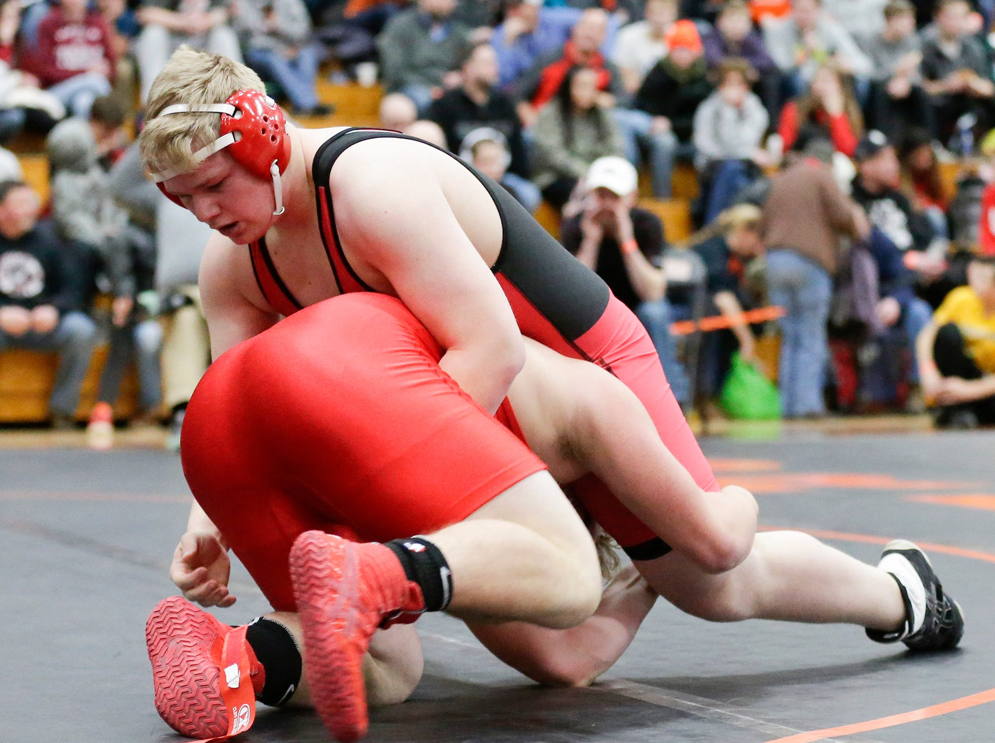 Collin Neuens of Neenah High School wrestles Alec Perelshtein of Homestaed High School in the 220 pound weight class during the WIAA sectionals Saturday, February 16, 2019 in Hartford, Wis. Perelshtein won with a pin. Doug Raflik/USA TODAY NETWORK-Wisconsin