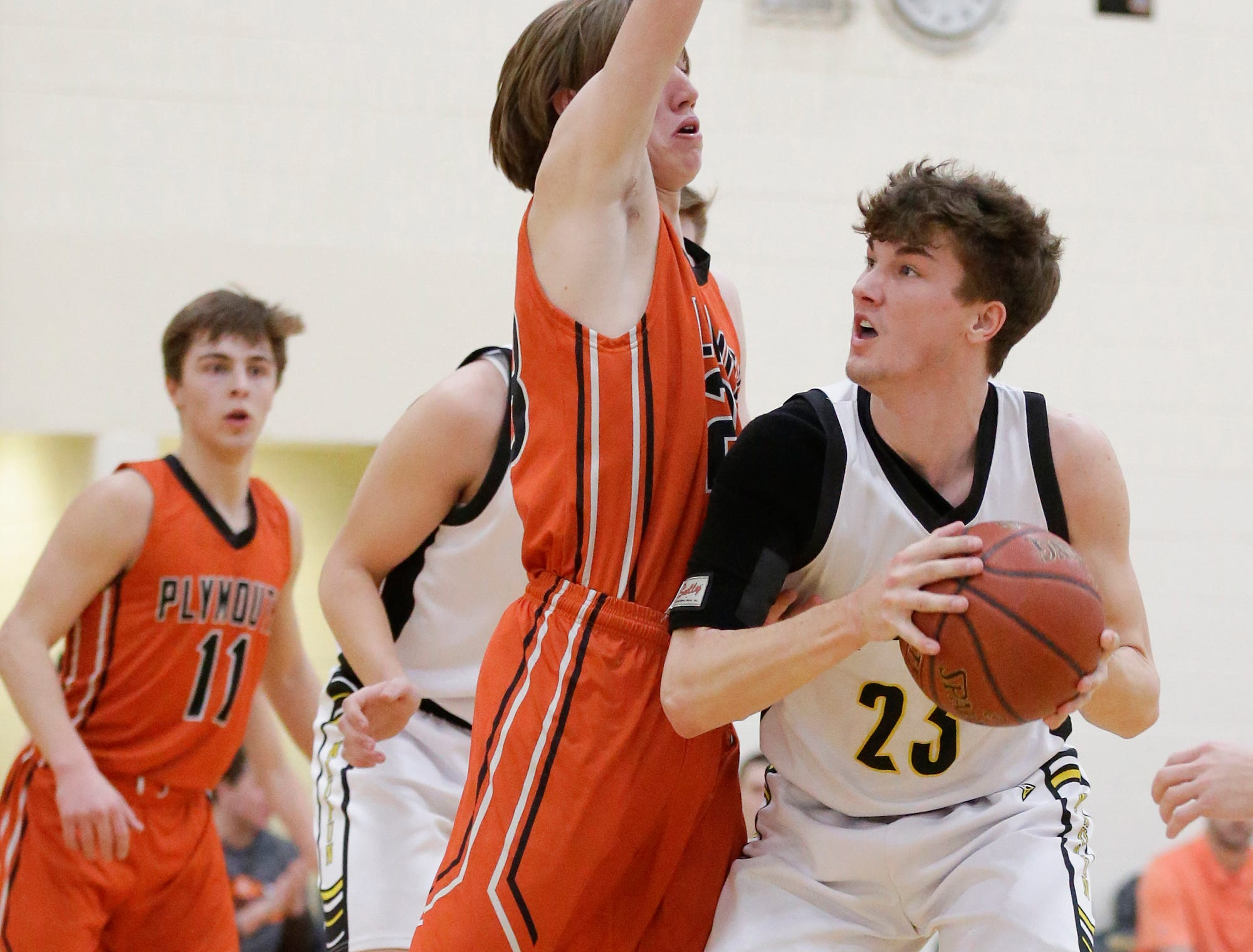 Waupun High School boys basketball's Reece Homan eyes up the basket while being defended by Plymouth High School's Zach Zeeveld during their game Friday, February 15, 2019 in Waupun. Doug Raflik/USA TODAY NETWORK-Wisconsin