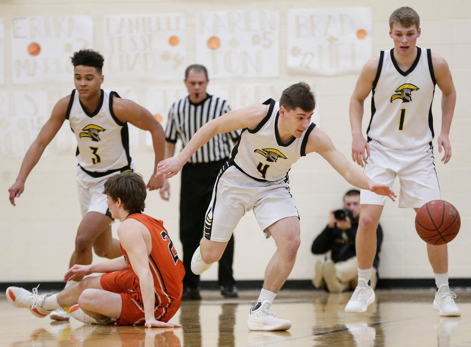 Waupun High School boys basketball's Benet Veleke (4) goes after a loose ball against Plymouth High School during their game Friday, February 15, 2019 in Waupun. Doug Raflik/USA TODAY NETWORK-Wisconsin