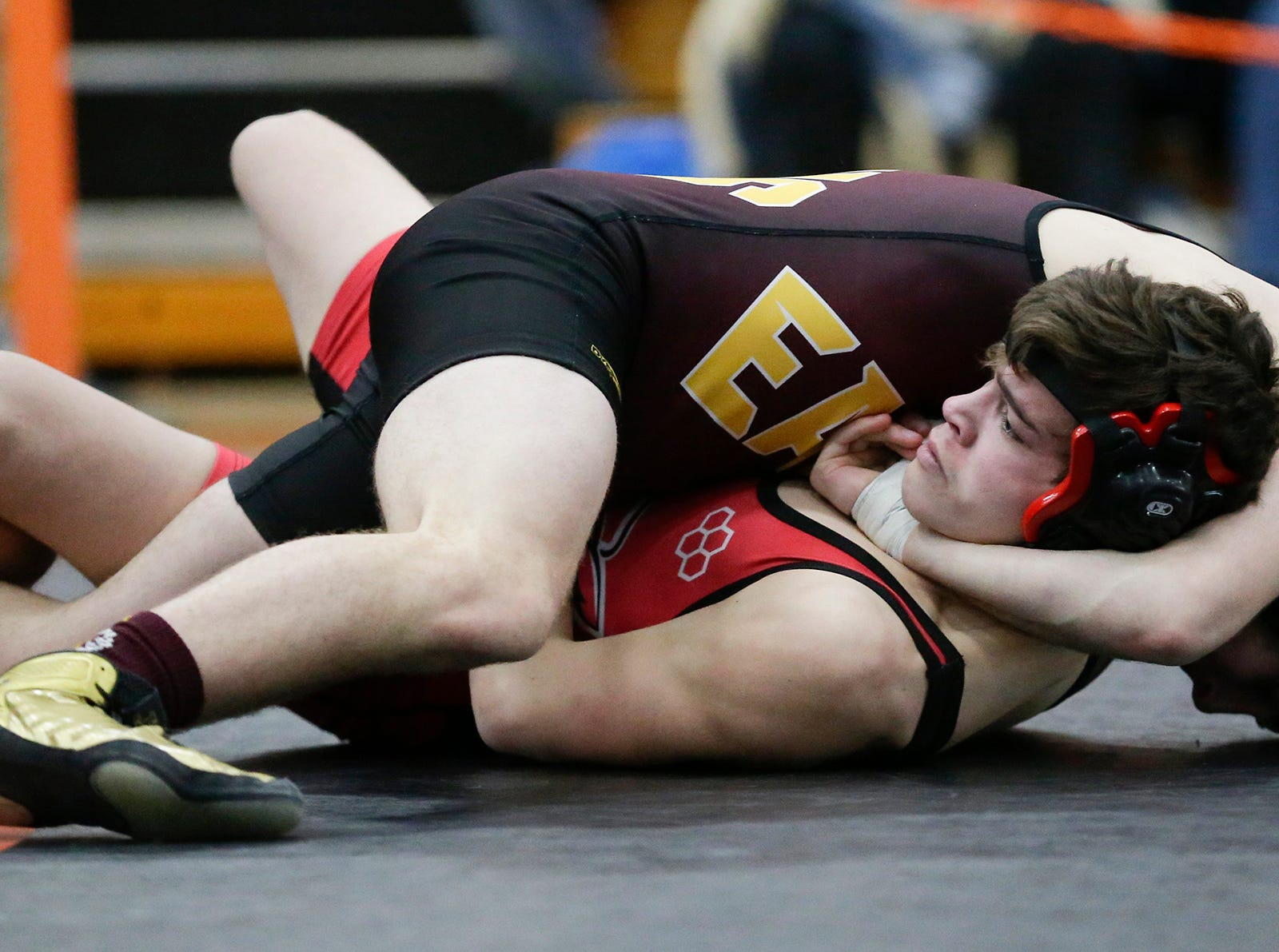 Austin Lewis of Neenah High School wrestles Cayden Henschel of West Bend West High School in the 132 pound weight class during the WIAA sectionals Saturday, February 16, 2019 in Hartford, Wis. Henschel won with a pin. Doug Raflik/USA TODAY NETWORK-Wisconsin
