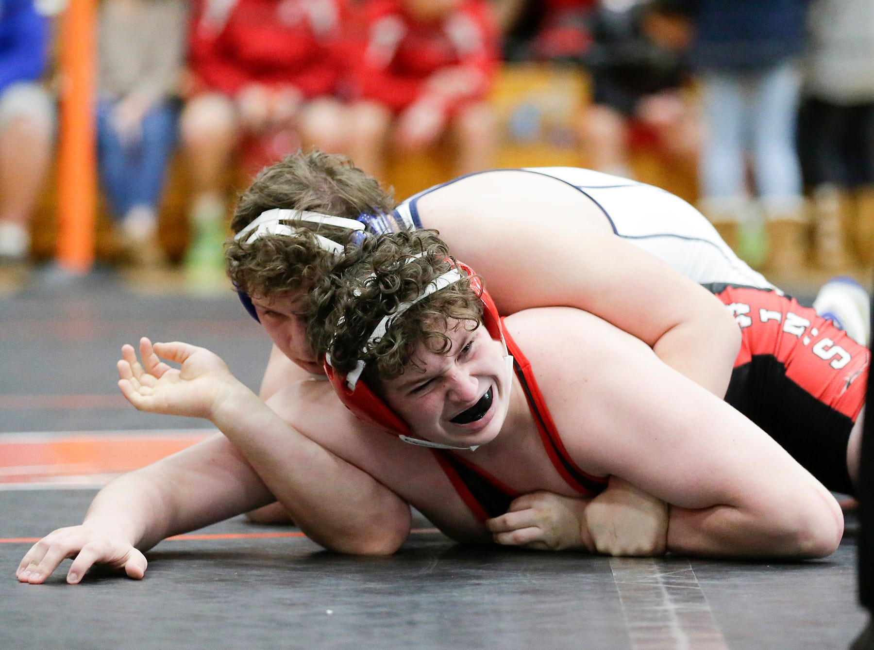 Blake Pudwell of West Bend West High School wrestles Mitchell Prueser of Sheboygan South High School in the 220 pound weight class during the WIAA sectionals Saturday, February 16, 2019 in Hartford, Wis. Pudwell won with a score of 13-4. Doug Raflik/USA TODAY NETWORK-Wisconsin