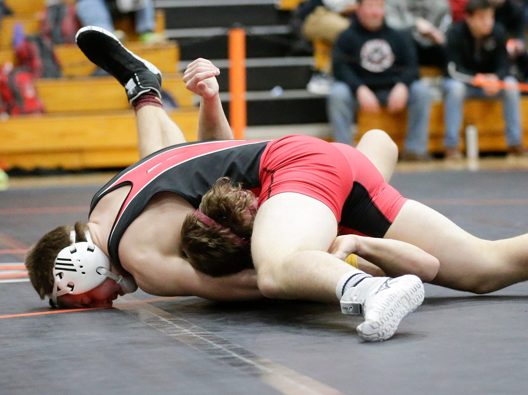 Isaiah McCormick of Neenah High School wrestles Brady Schmidt of West Bend East High School in the 170 pound weight class during the WIAA sectionals Saturday, February 16, 2019 in Hartford, Wis. McCormick won with a pin. Doug Raflik/USA TODAY NETWORK-Wisconsin
