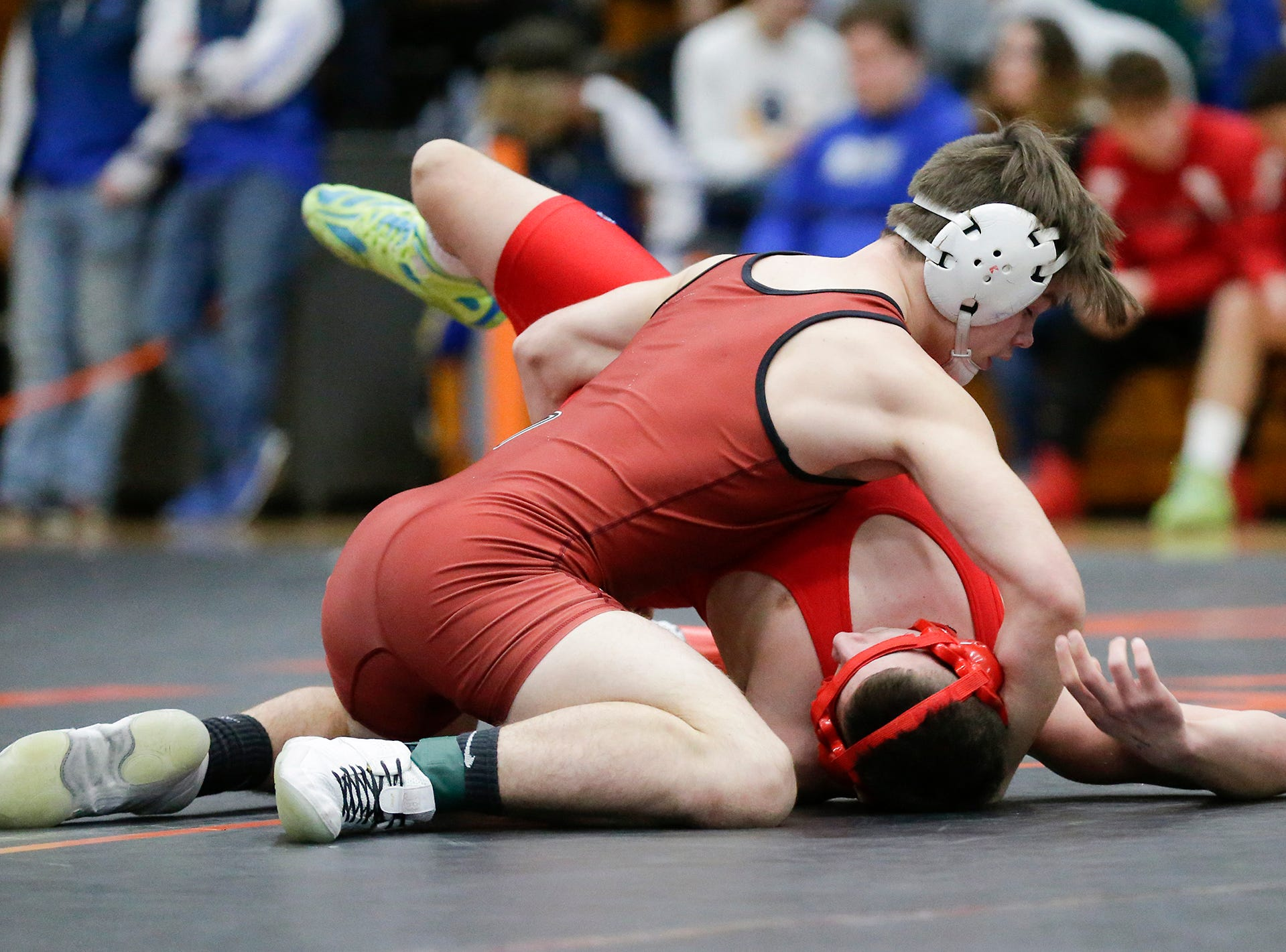 Josiah Streblow of Fond du Lac High School wrestles Guy Tamim ofHomestead  High School in the 152 pound weight class during the WIAA sectionals Saturday, February 16, 2019 in Hartford, Wis. Streblow won with a pin. Doug Raflik/USA TODAY NETWORK-Wisconsin