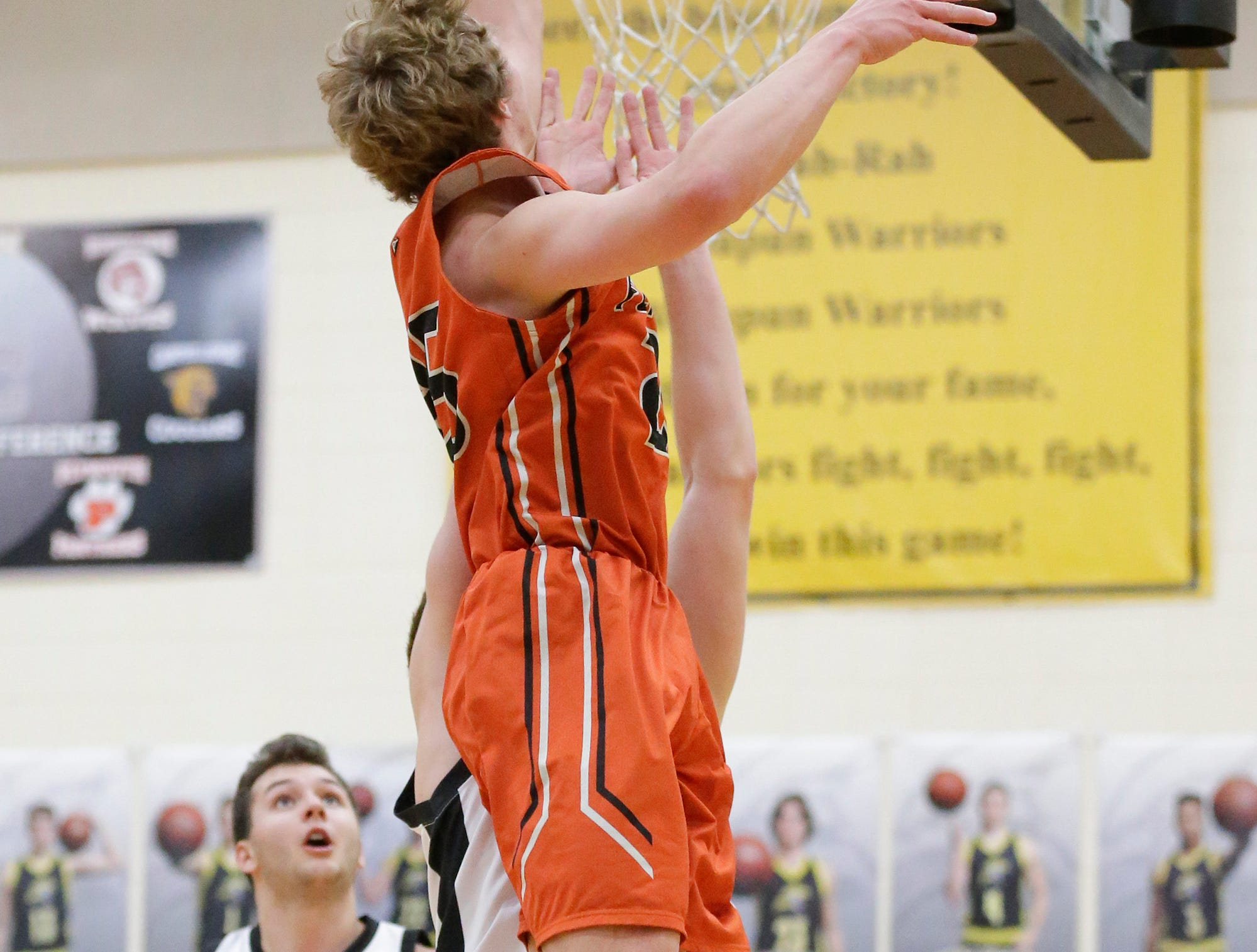 Plymouth High School boys basketball's Aiden Reilly goes up for a shot against Waupun High School during their game Friday, February 15, 2019 in Waupun. Doug Raflik/USA TODAY NETWORK-Wisconsin
