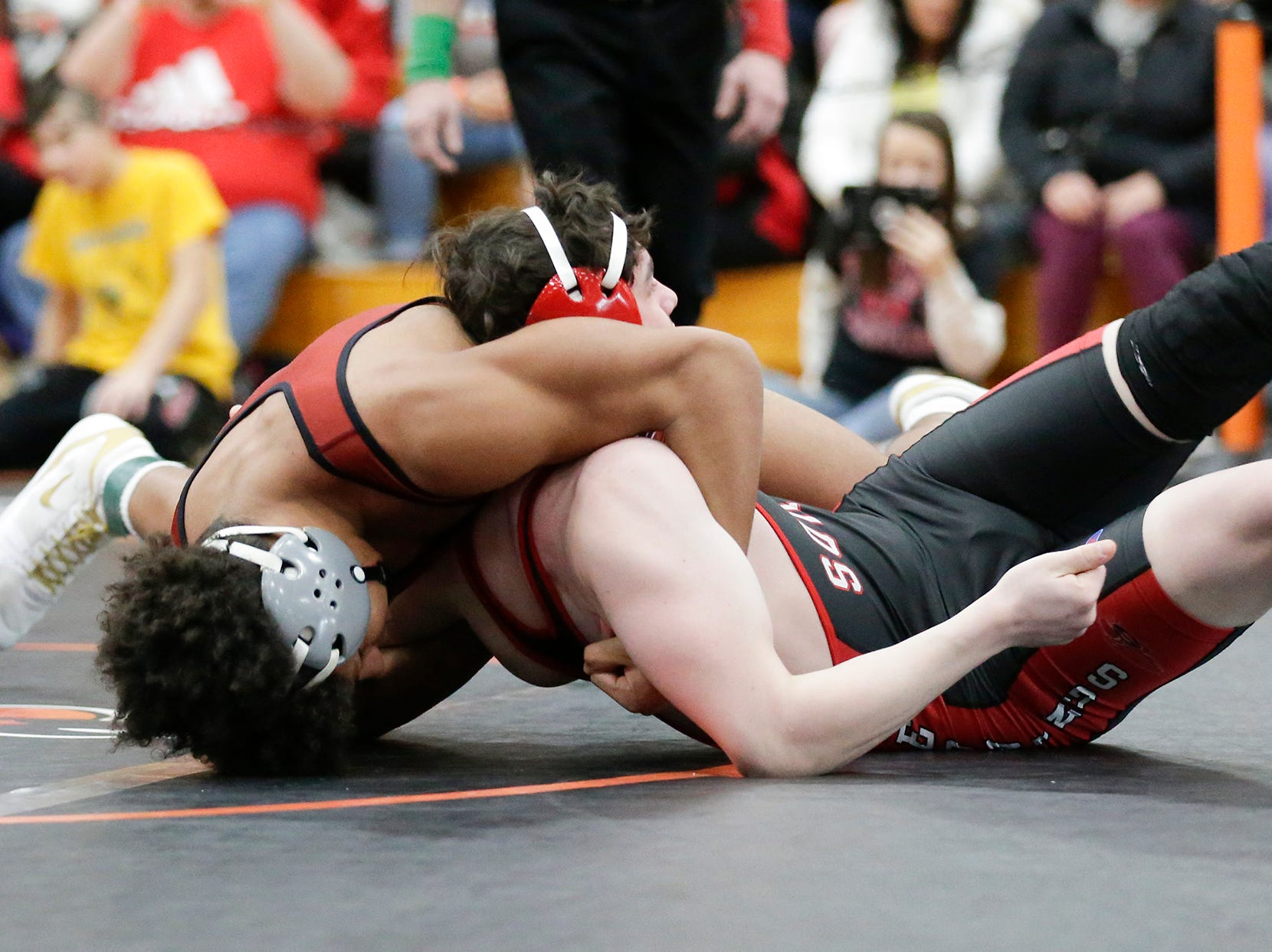 Braelon Allen of Fond du Lac High School wrestles Aden Katz of Sheboygan South High School in the 182 pound weight class during the WIAA sectionals Saturday, February 16, 2019 in Hartford, Wis. Allen won with a pin in 10 seconds. Doug Raflik/USA TODAY NETWORK-Wisconsin