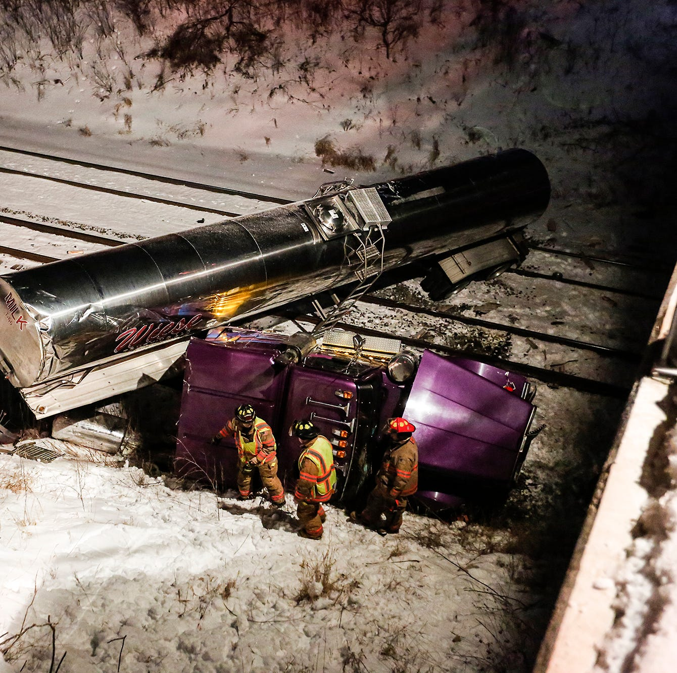 Man injured Friday night after semi falls from overpass on to railroad tracks