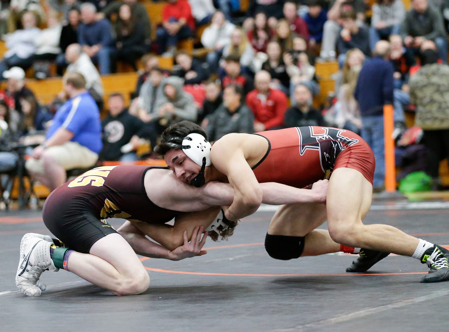 Issac Ortegon of Fond du Lac High School wrestles Jordan Ward of West Bend East High School in the 138 pound weight class during the WIAA sectionals Saturday, February 16, 2019 in Hartford, Wis. Ortegon won with a score of 20-6. Doug Raflik/USA TODAY NETWORK-Wisconsin
