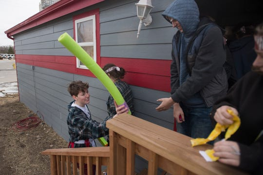 Polaris student Elliot Schaibly uses a foam katana to dispatch students acting as zombies during a zombie survival simulation on Thursday, Feb. 14, 2019, at the Poudre Fire Authority tarring facility in Fort Collins, Colo. In this simulation Schaibly's team was tasked with entering the house and collecting supplies scattered around the home while avoiding the zombie horde inside and around the house.
