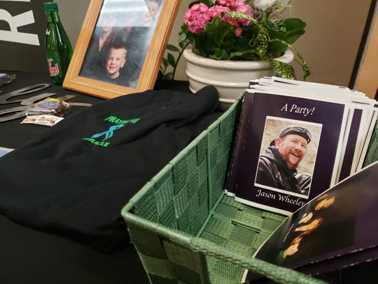 """Items were placed on a table outside the Foundations Church auditorium for the celebration of life for William Jason Wheeler, who died during a road rage incident in Loveland Feb. 8. Family called the memorial """"a party,"""" because they say that's what Wheeler would have wanted."""