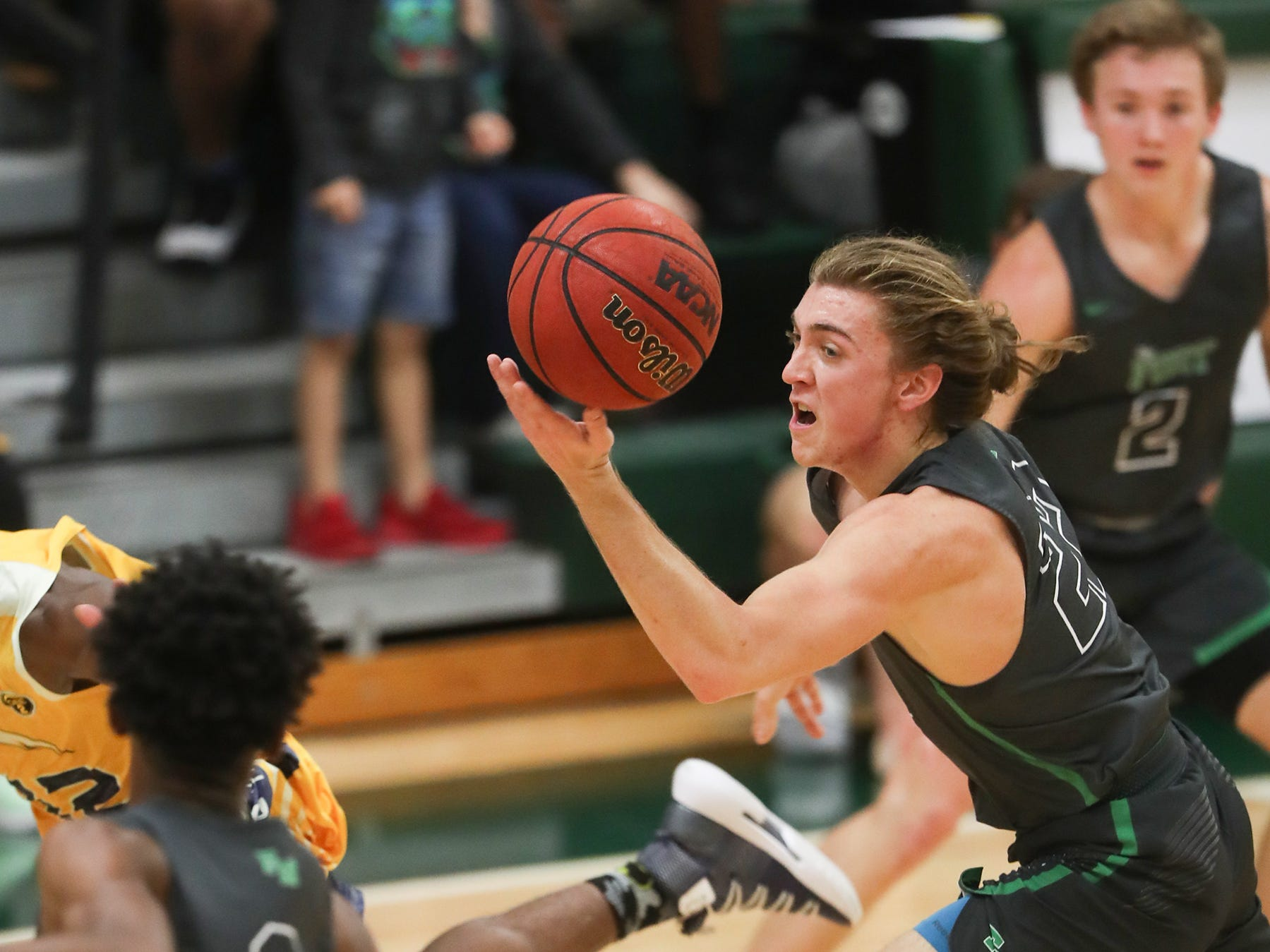 Fort Myers High School's Michael Roberts, right, drives to the basket against Lehigh on Friday in the Class 7A-11 championship game in Fort Myers. Fort Myers beat Lehigh 59-56.