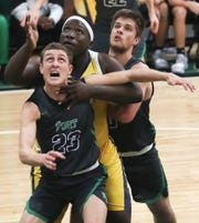 Fort Myers High School's Josh Gergley, front, rebounds against Lehigh's Debo Massolas on Friday in the Class 7A-11 championship game in Fort Myers. Fort Myers beat Lehigh 59-56.