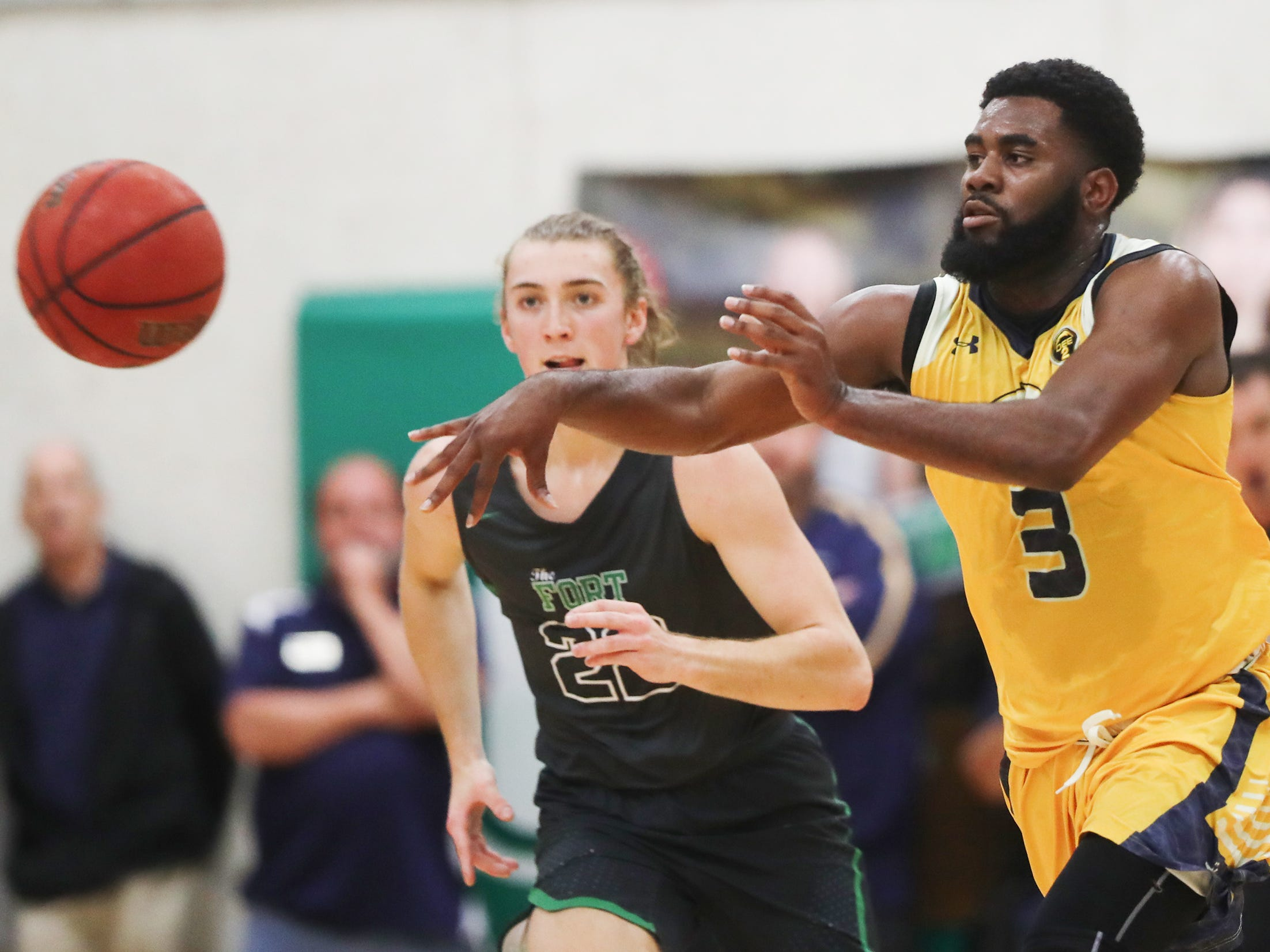 Lehigh High School's Delshawn Green passes against Fort Myers on Friday in the Class 7A-11 championship game in Fort Myers. Fort Myers beat Lehigh 59-56.