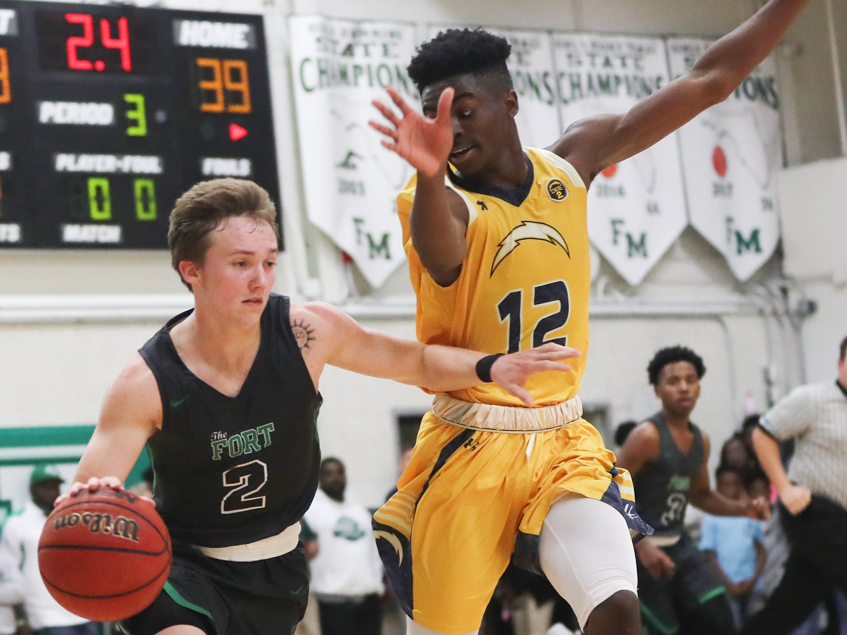 Fort Myers High School's Bradley Merilus, left, drives to the basket against Lehigh on Friday in the Class 7A-11 championship game in Fort Myers. Fort Myers beat Lehigh 59-56.