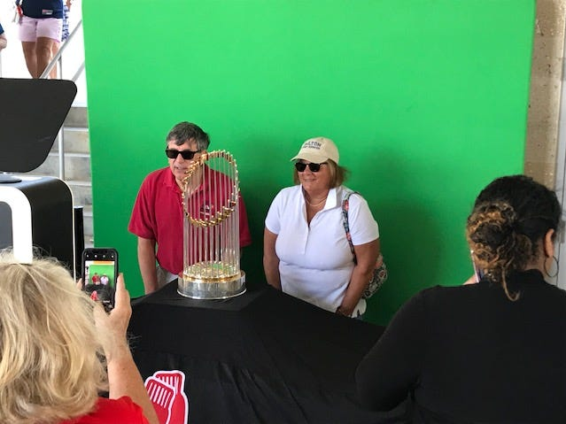 The Boston Red Sox celebrated their 2018 World Series championship Saturday, Feb. 16, 2019 at JetBlue Park at Fenway South in Fort Myers. Fans took photos with the World Series trophy and in front of the Green Monster in left field.