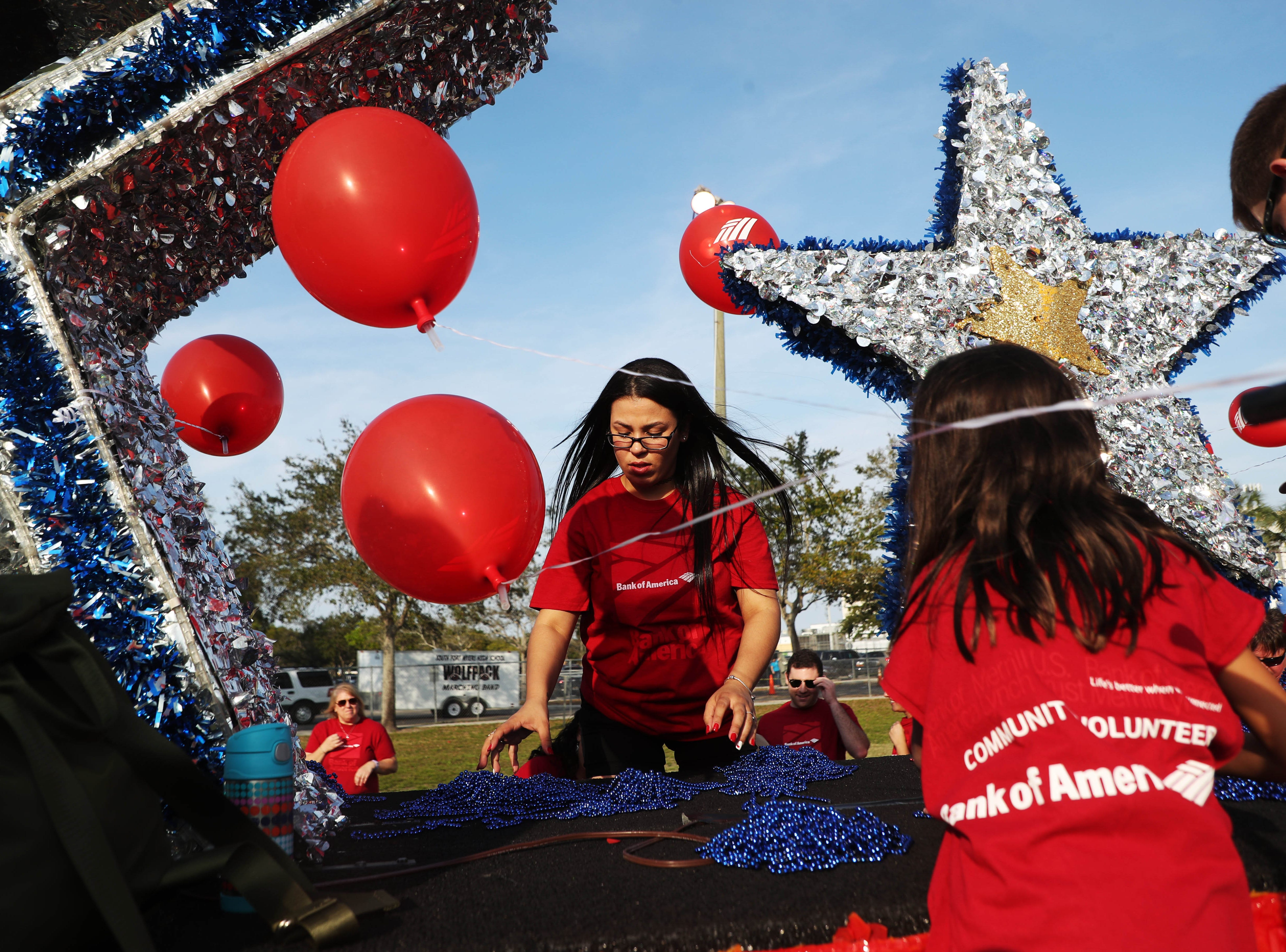 Dennia Rodriguez, a Bank of America employee prepares the float she will be riding during the Edison Festival of Light Grand Parade on Saturday 2/16/2019 at Fort Myers High School.