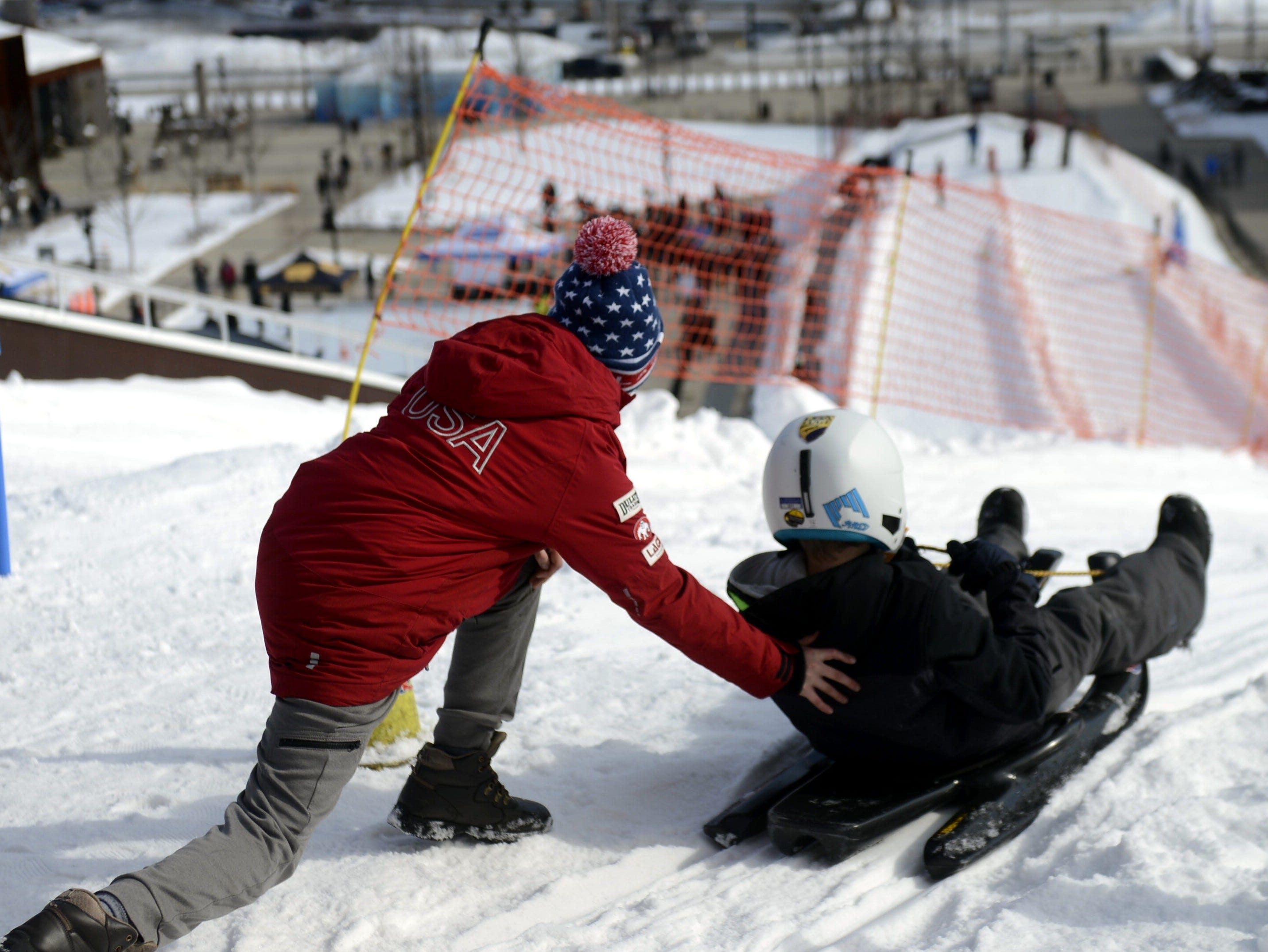 A luge rider gets a push from the top of Ariens Hill during the Titletown Winter Games on Saturday, Feb. 16, 2019.