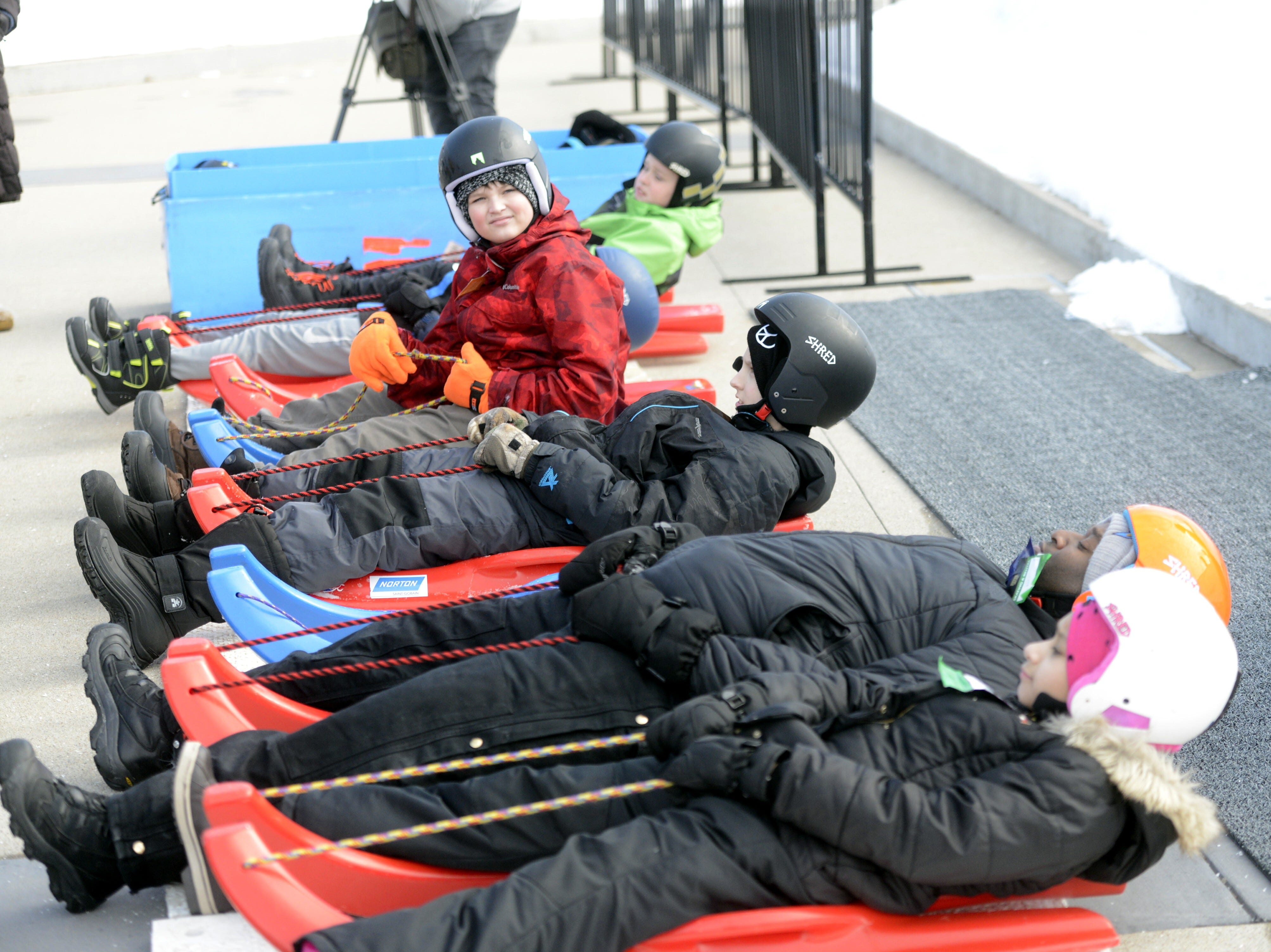 Participants practice for the luge course at the Titletown Winter Games on Saturday, Feb. 16, 2019.