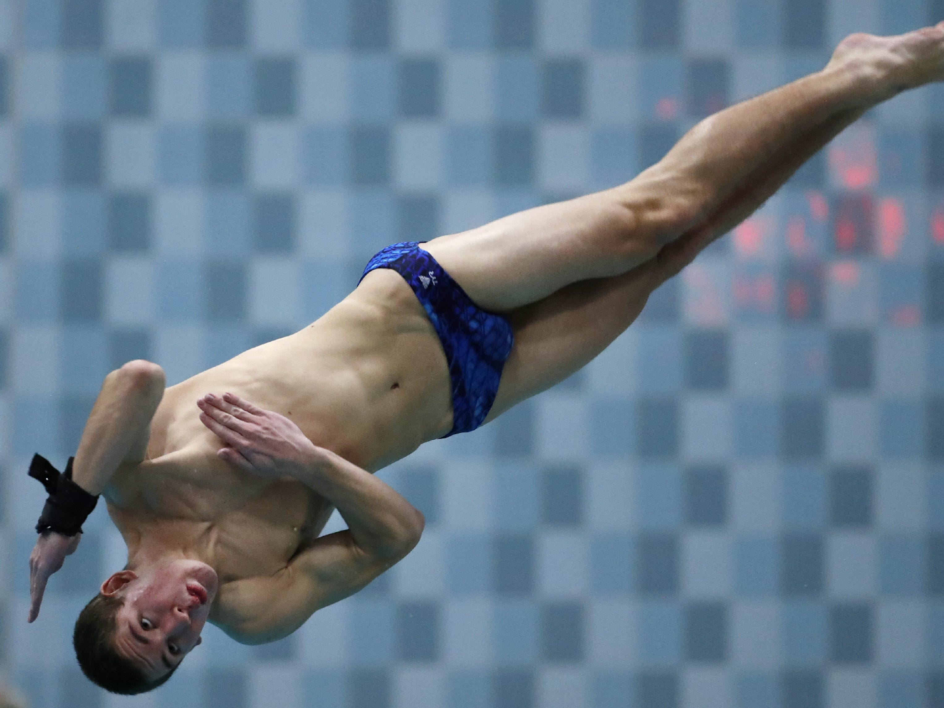 Brookfield Central/East's Braden Rumpit dives during the Division 1 2019 State Boys Swimming and Diving Championships Saturday, Feb. 16, 2019, at the UW Natatorium in Madison, Wis. Danny Damiani/USA TODAY NETWORK-Wisconsin