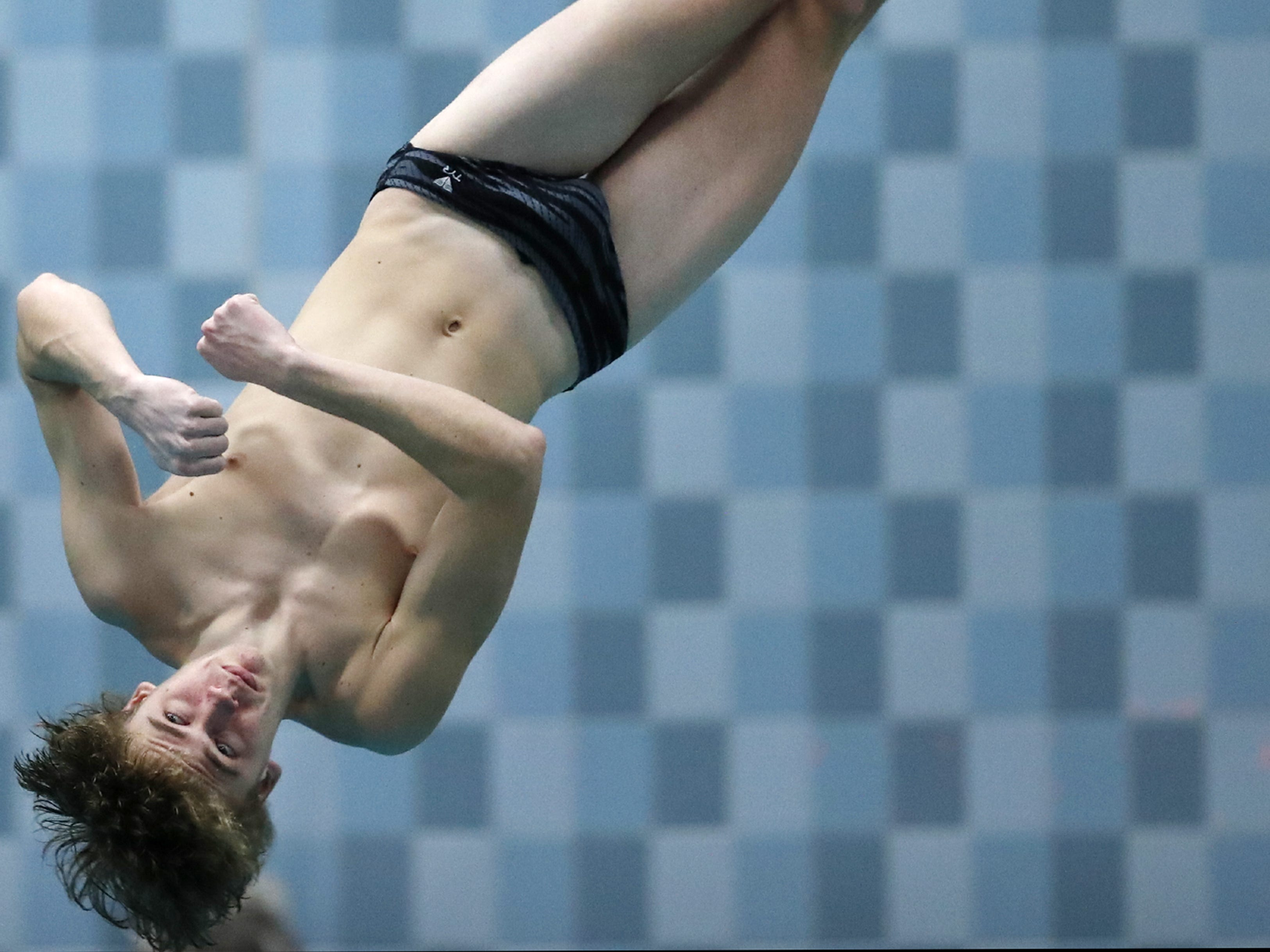 Appleton West/KimberlyÕs Nick O'Brien twists during a dive in the Division 1 2019 State Boys Swimming and Diving Championships Saturday, Feb. 16, 2019, at the UW Natatorium in Madison, Wis. Danny Damiani/USA TODAY NETWORK-Wisconsin
