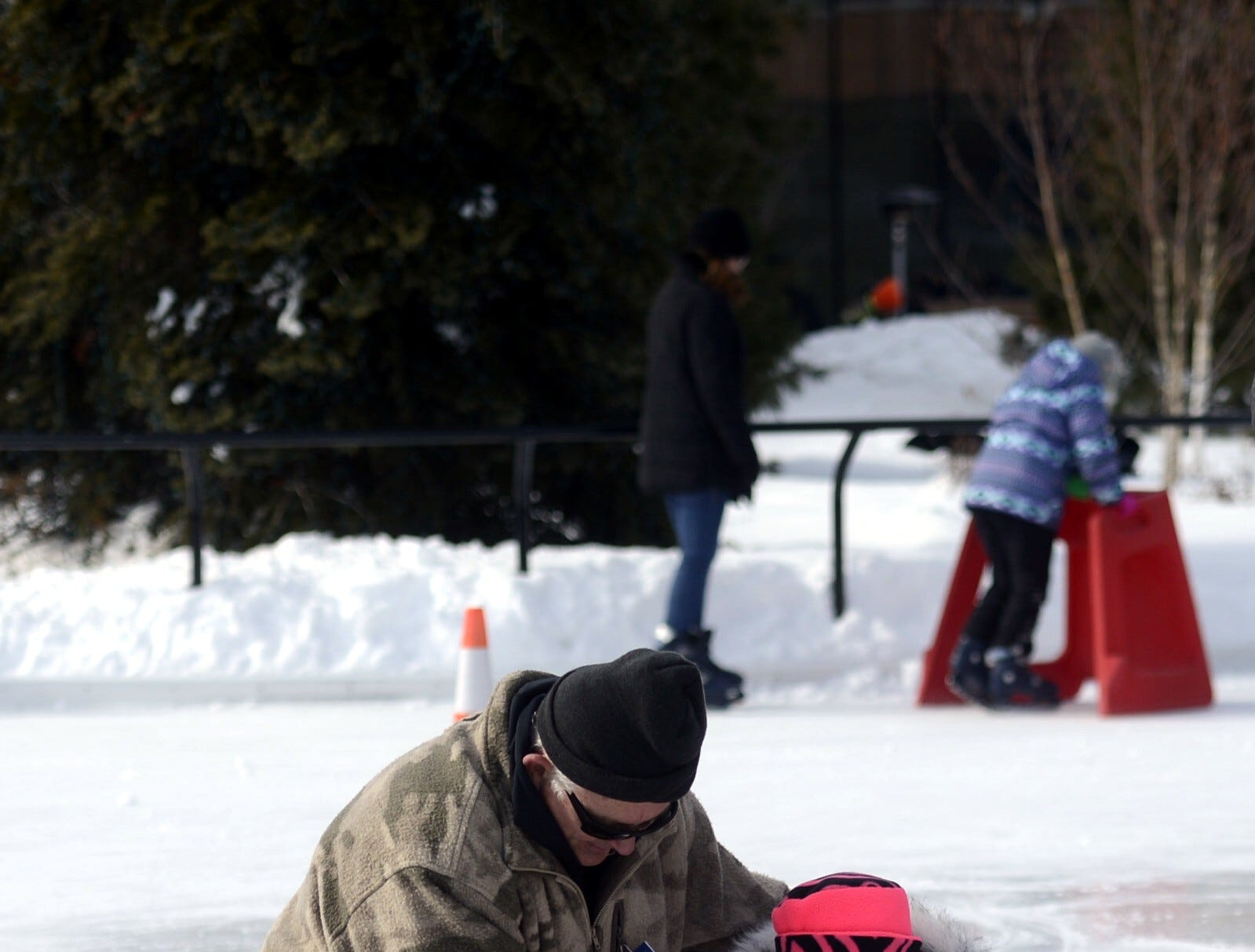 Caitlyn LaFond, 6, of Green Bay tries curling during the Titletown Winter Games on Saturday, Feb. 16, 2019.