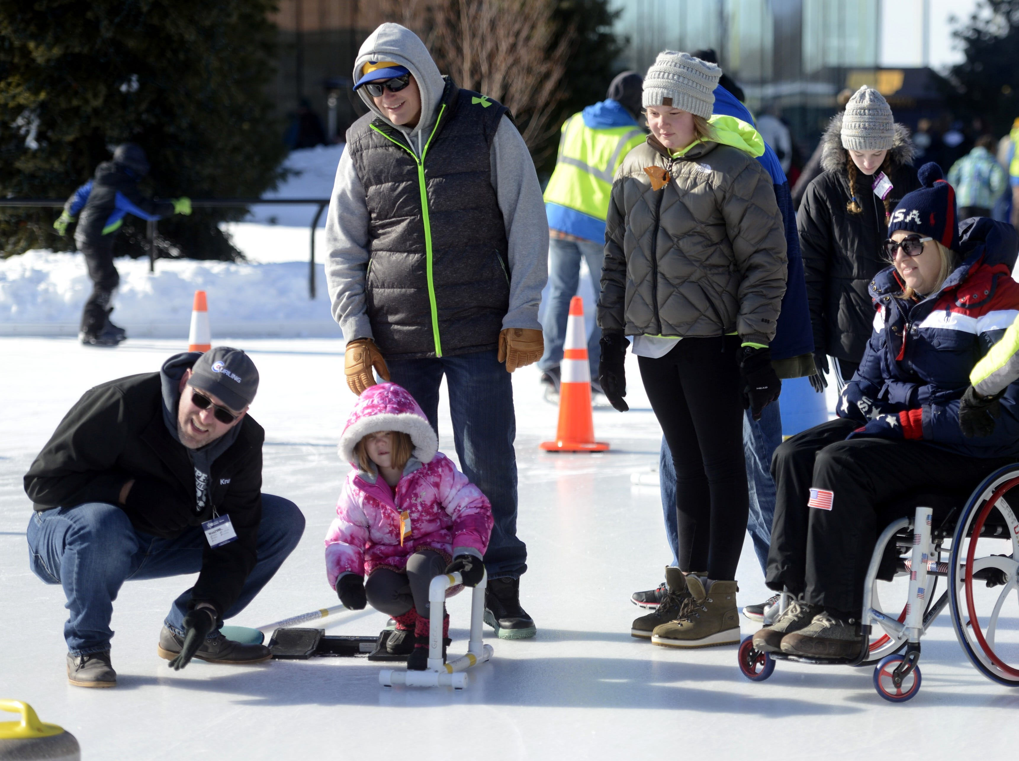 Kendra Lins, 4, of Green Bay of Green Bay tries curling during the Titletown Winter Games on Saturday, Feb. 16, 2019.