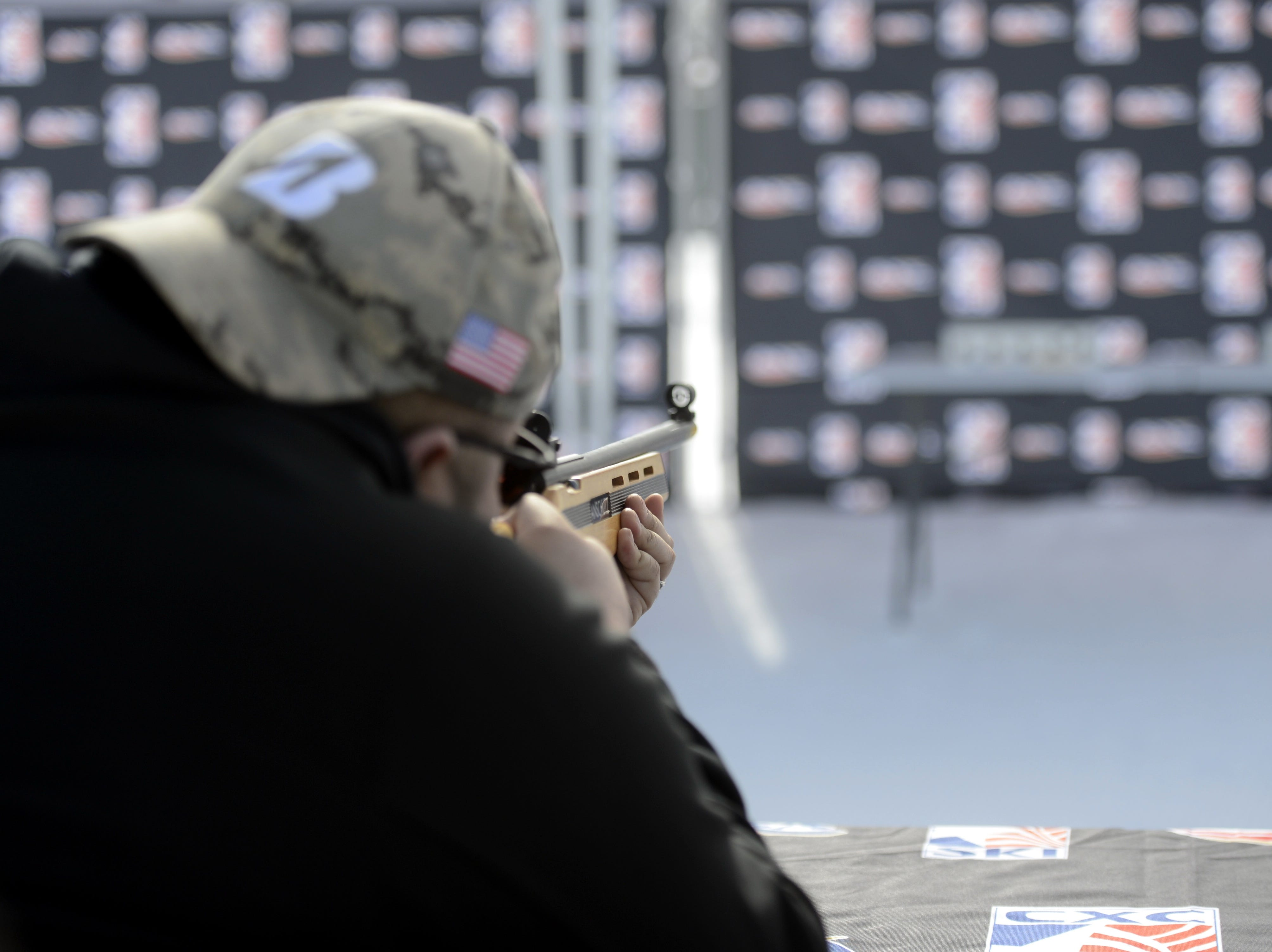 A competitor aims at targets with a laser rifle as part of the biathlon event during the Titletown Winter Games on Saturday, Feb. 16, 2019.