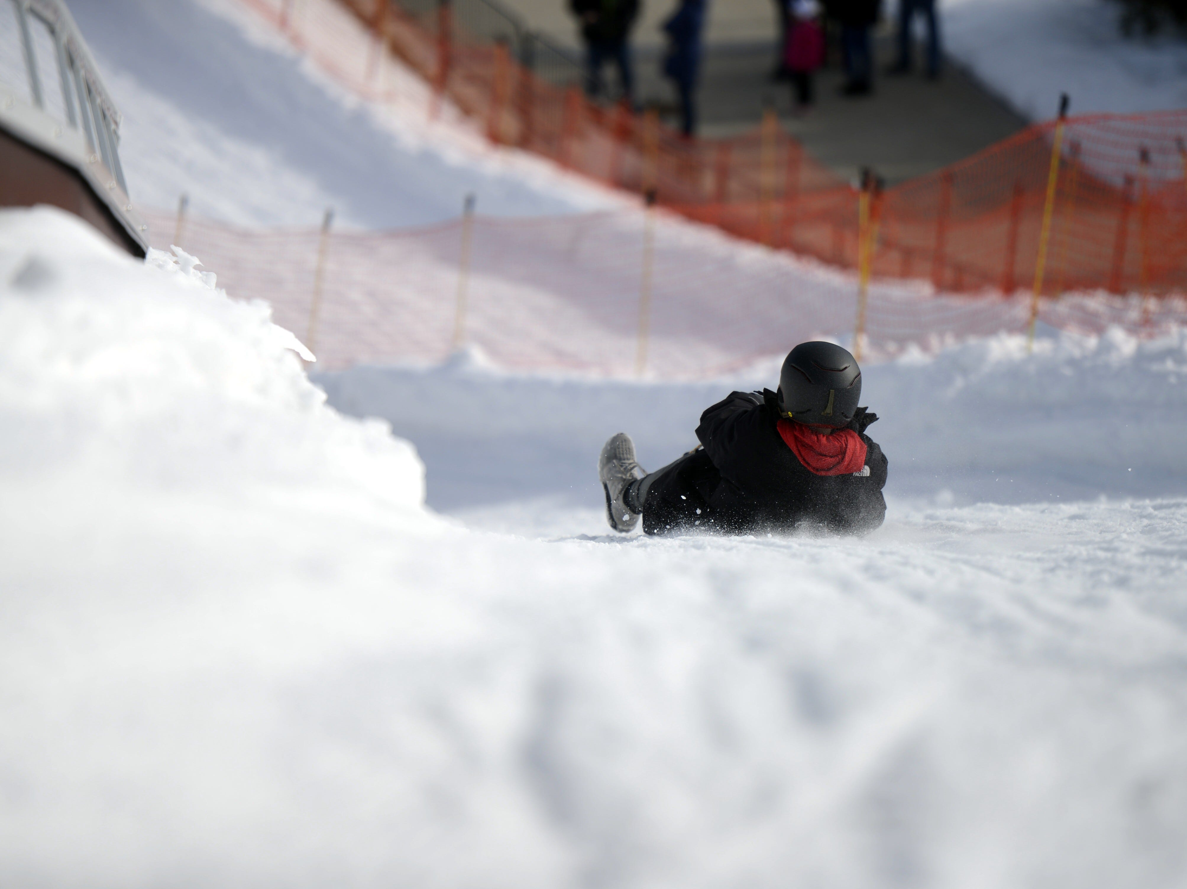 A rider goes down the luge hill at the Titletown Winter Games on Saturday, Feb. 16, 2019.