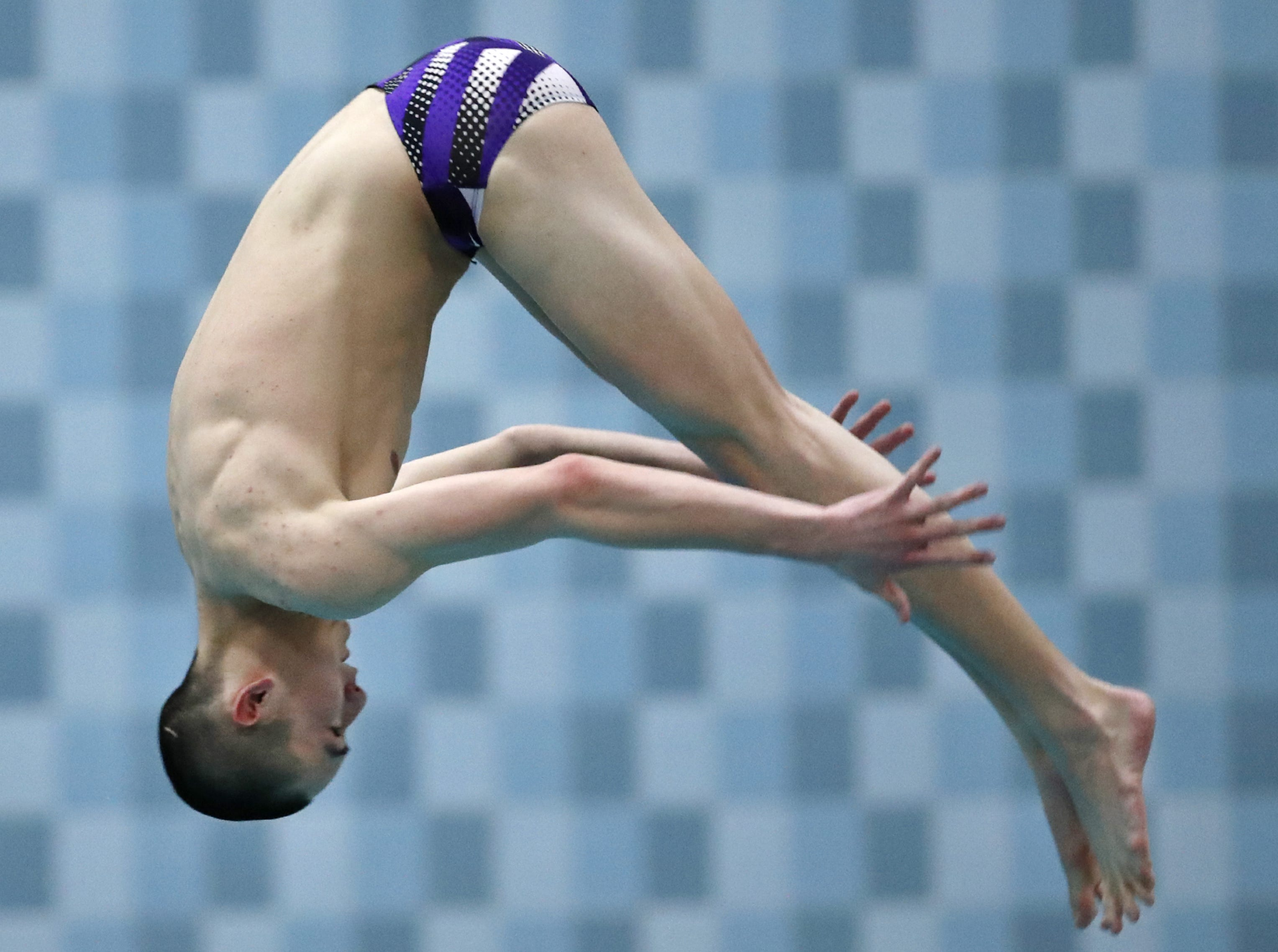 Kiel/Elkhart Lake-Glenbeulah's Charlie Tanouye competes in the diving portion of the Division 2 2019 State Boys Swimming and Diving Championships Friday, Feb. 15, 2019, at the UW Natatorium in Madison, Wis. Danny Damiani/USA TODAY NETWORK-Wisconsin