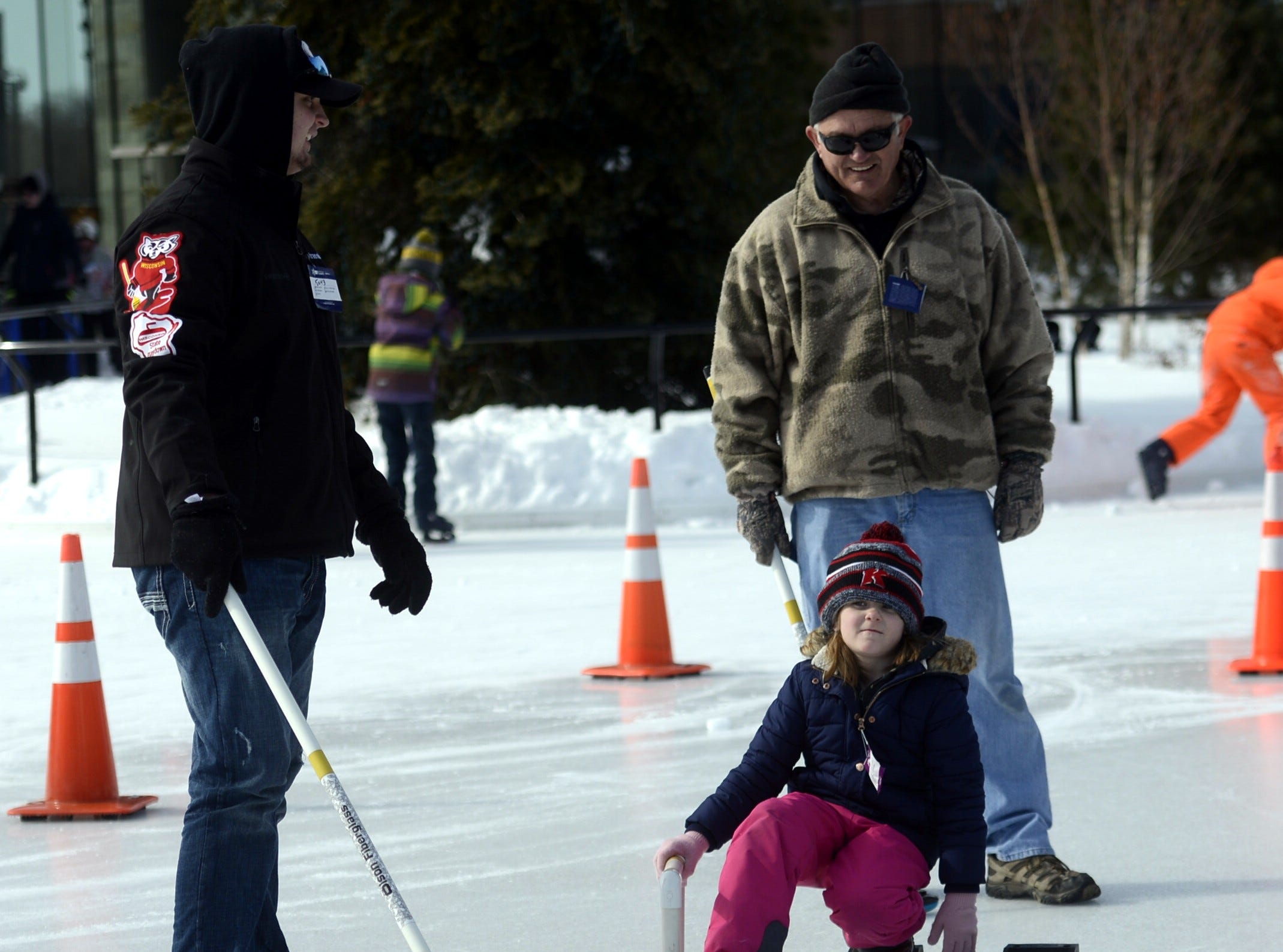 Lily Roddy, 6, of Kimberly tries curling during the Titletown Winter Games on Saturday, Feb. 16, 2019.